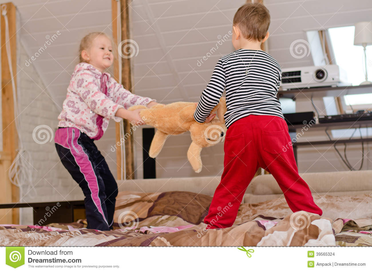 Cute Brother And Sister Having A Tug Of War Stock Photo