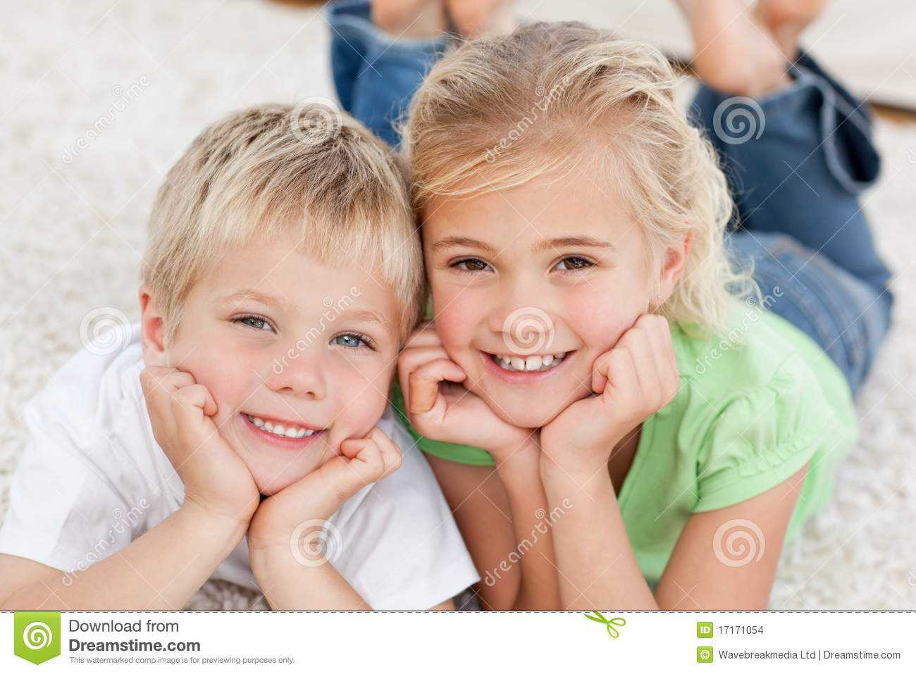 Cute Brother And Sister Lying On The Floor Stock Photo Image Of