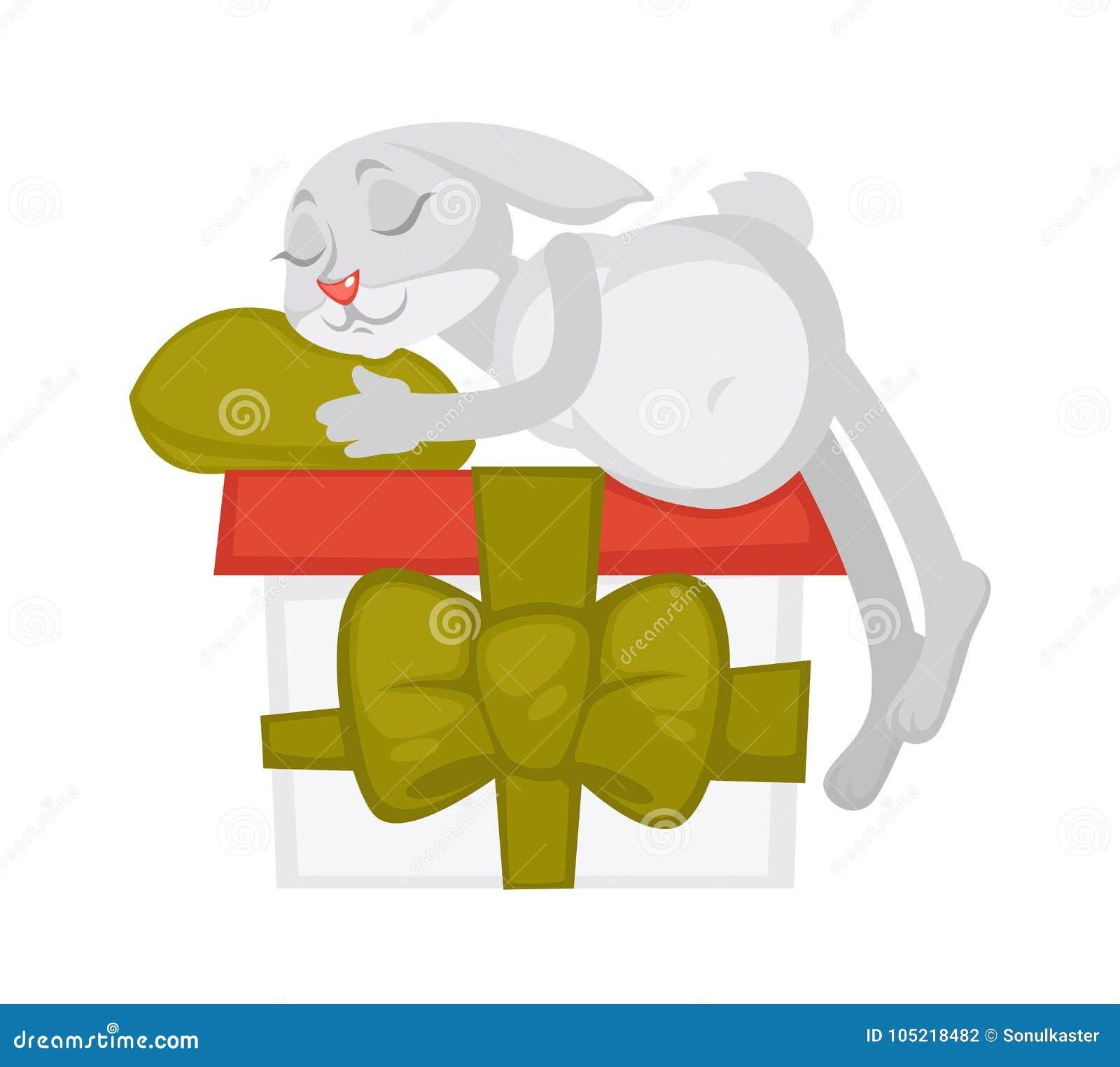 Bunny sleeps on huge gift box with ribbon and bow