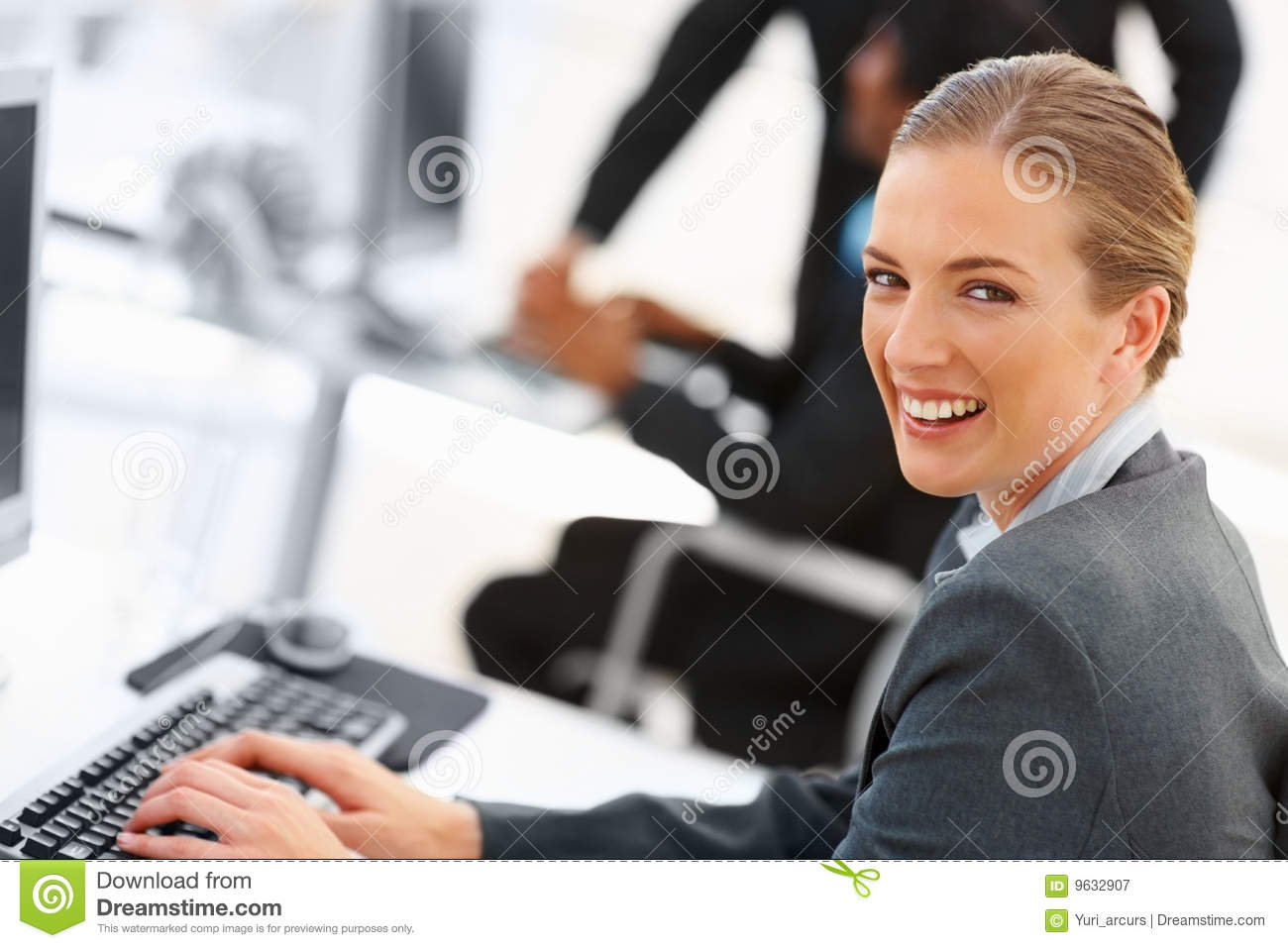Cute business woman working on the computer