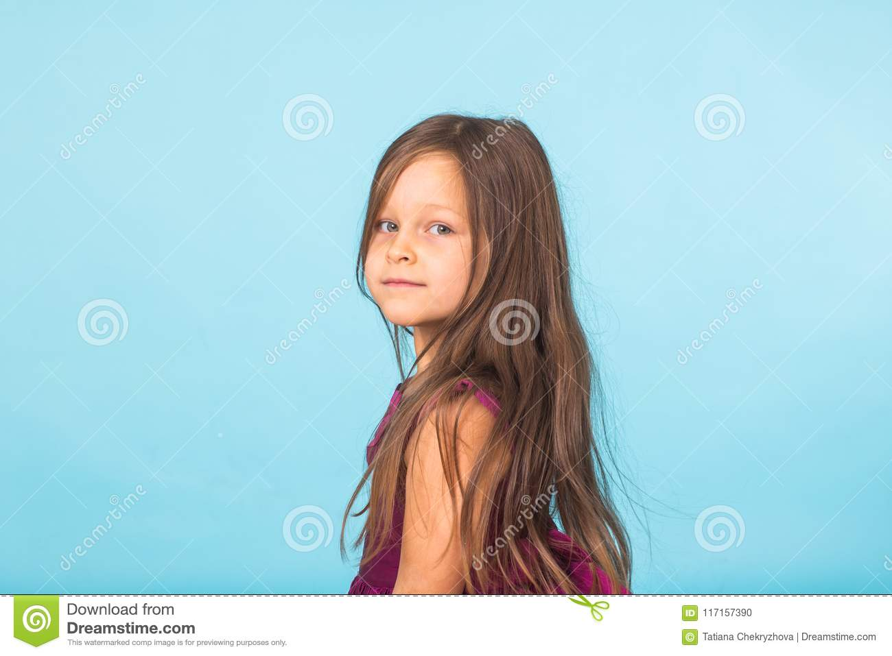 Cute cheerful little girl portrait, isolated on blue background