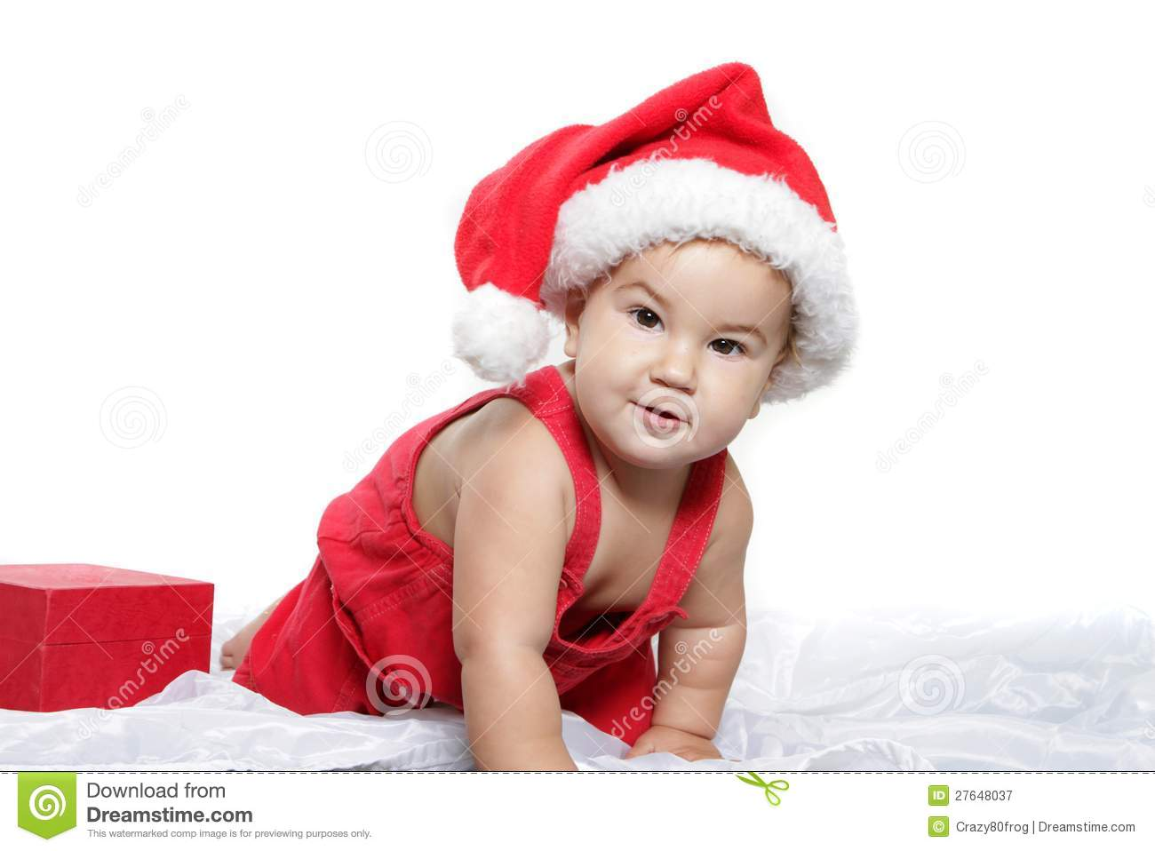 80c69f74778 Christmas studio portrait of cute child baby in santa hat isolated over  white