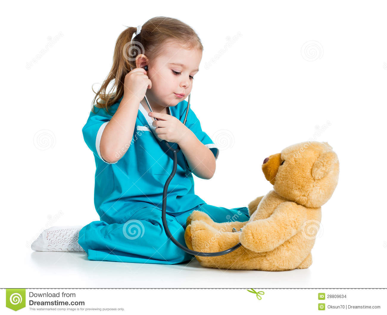 cute child with clothes of doctor examining teddy bear toy stock