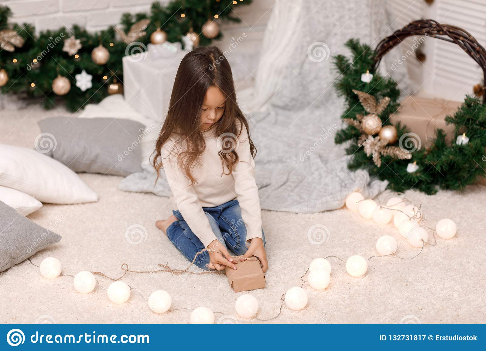 Cute Christmas Gifts For Girlfriend.Cute Child Girl Packing Christmas Gifts At Home Stock Image
