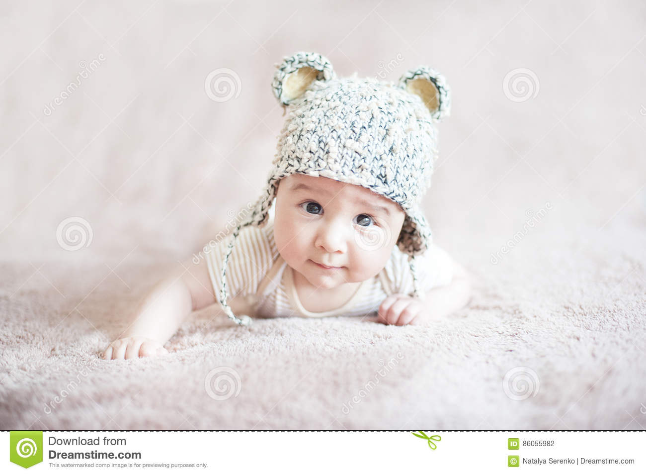 Cute child in knitted bear hat