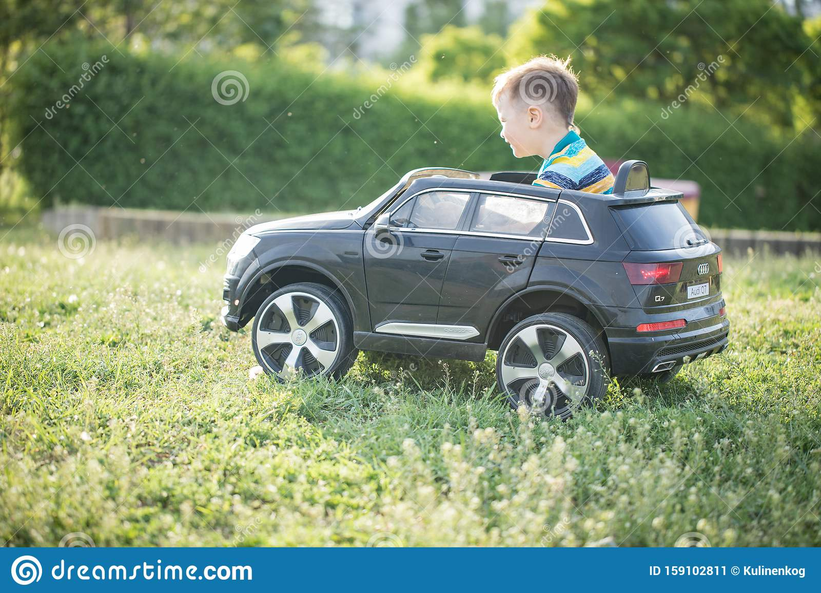 Cute Little Boy In Riding A Black Electric Car In The Park Stock Image Image Of Black Leisure 159102811