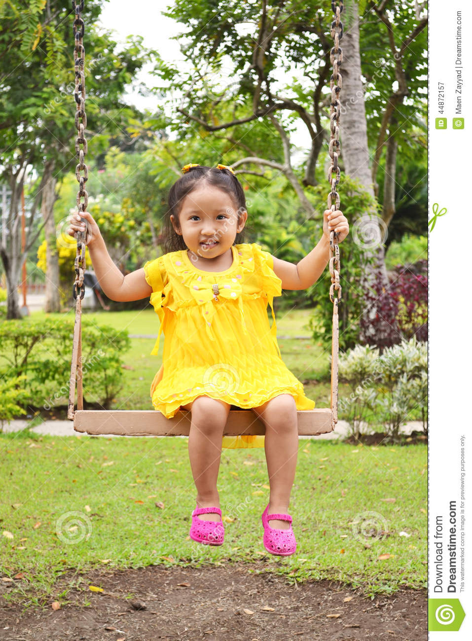 Cute Child On A Swing Stock Photo - Image: 44872157