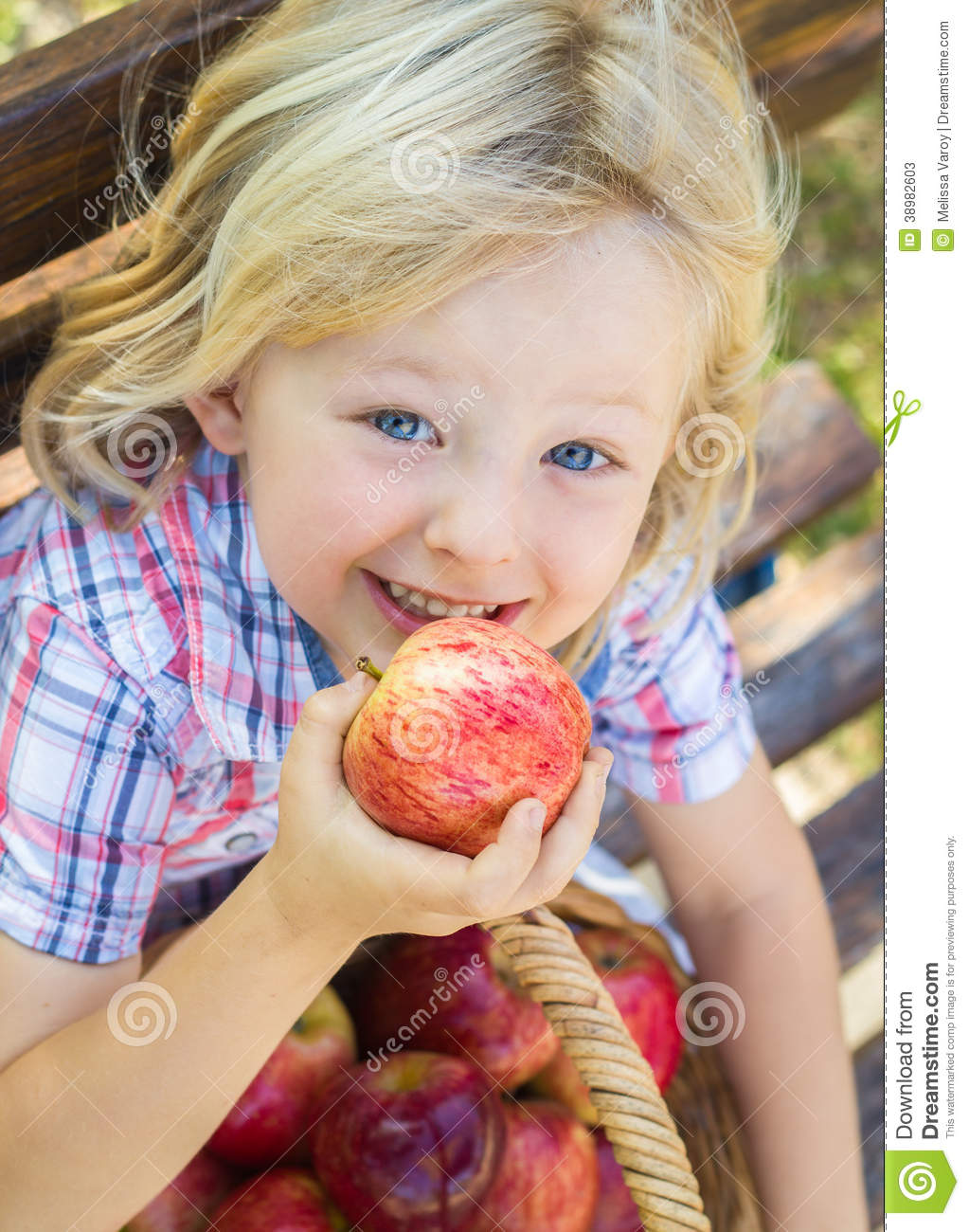 cute child about to eat a red apple stock photo image 38982603