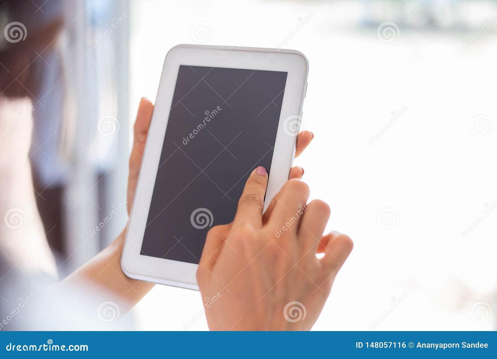 Cute child is using digital tablet