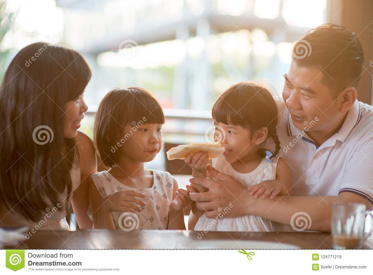 Asian family at cafe