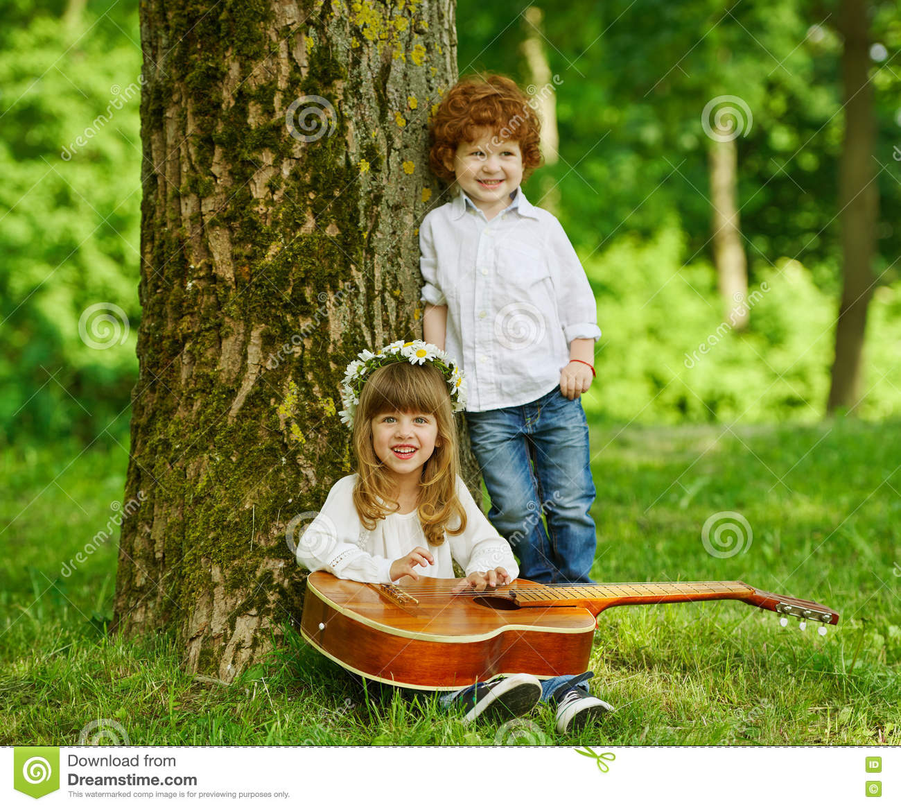 cute children playing guitar stock image - image of beautiful