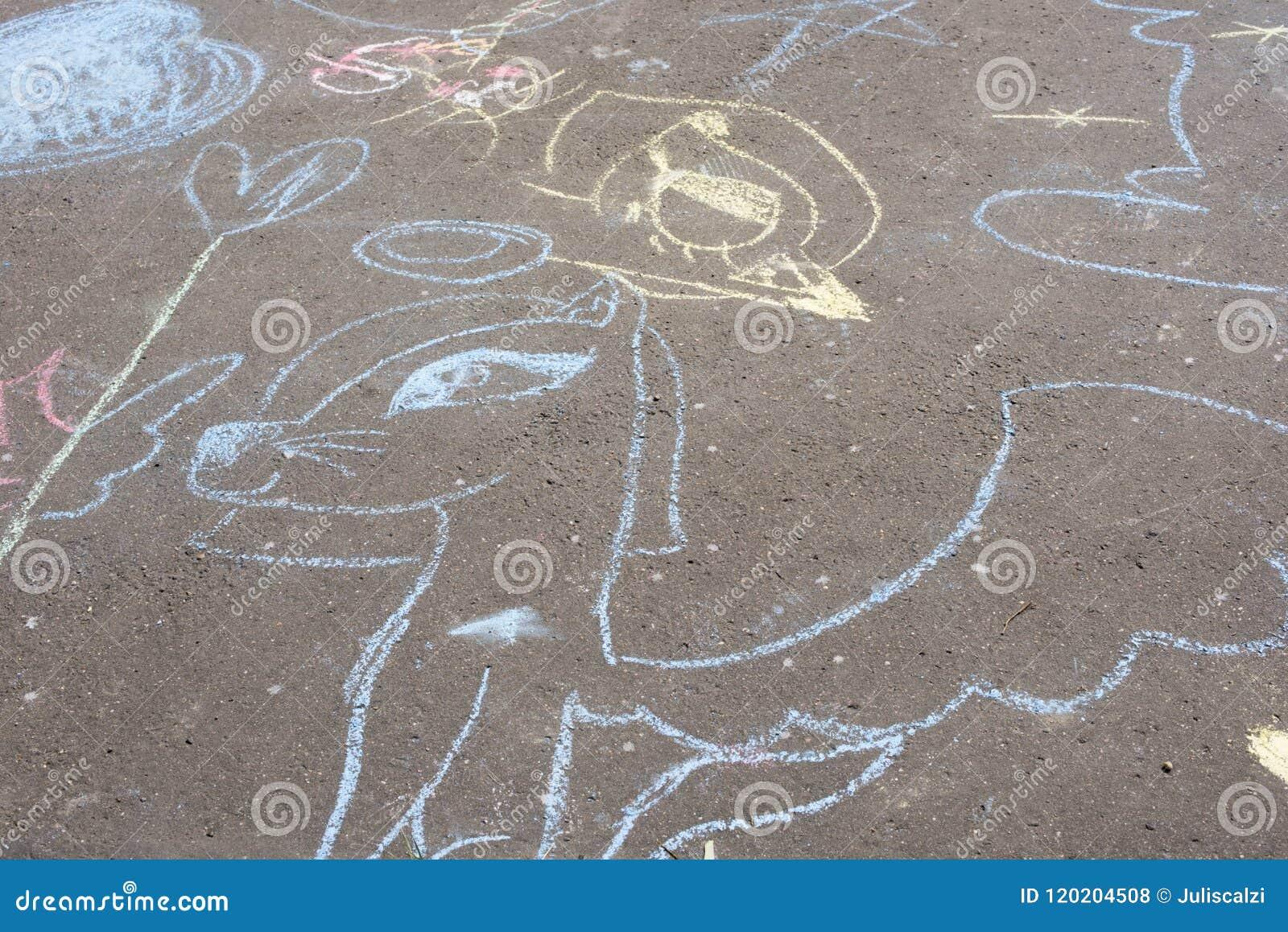 Children`s chalk drawings on ground