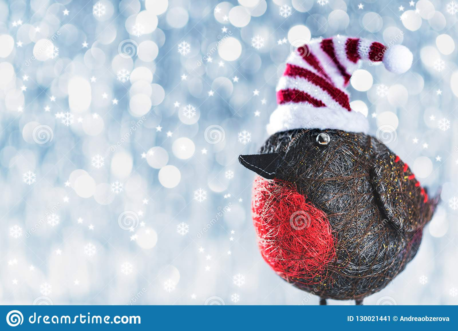 Cute Christmas Bird in Winter Wonderland. Christmas background.
