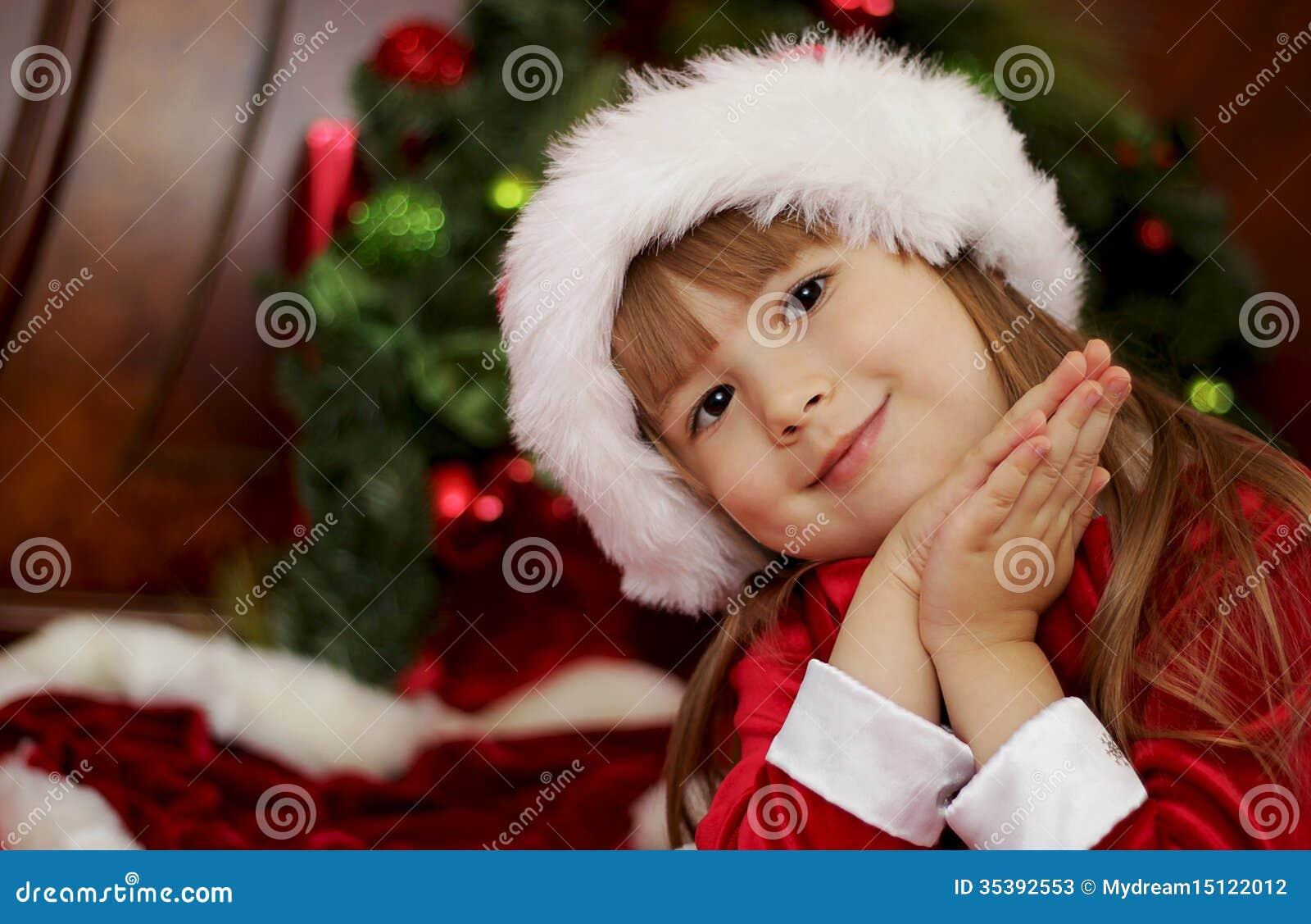 Cute christmas little girl in santa hat stock photos image 35392553