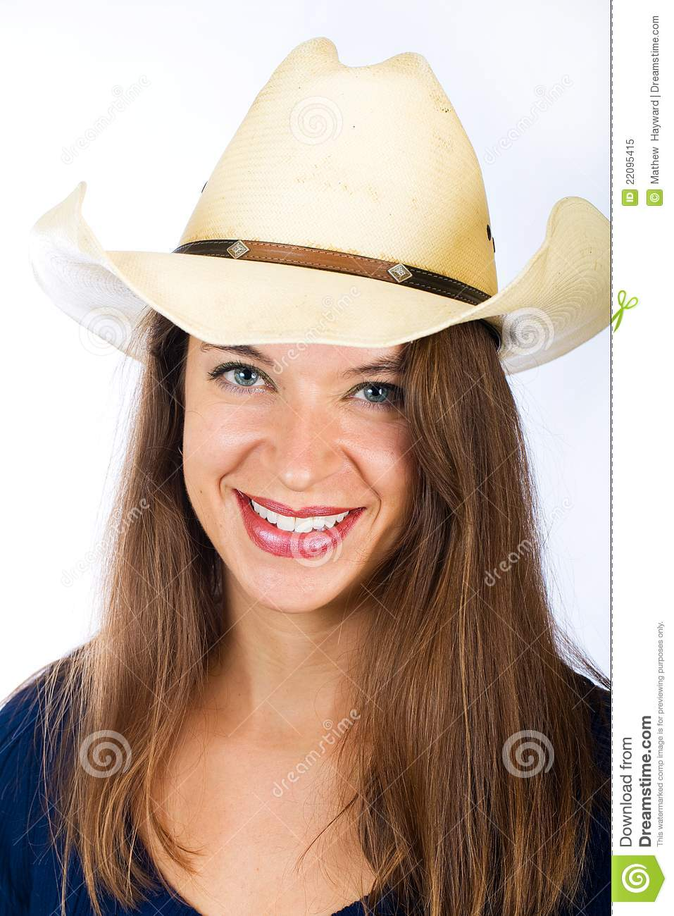 A pretty woman wearing a cowboy hat. She has a friendly smile on her face. 33c7e9c93400