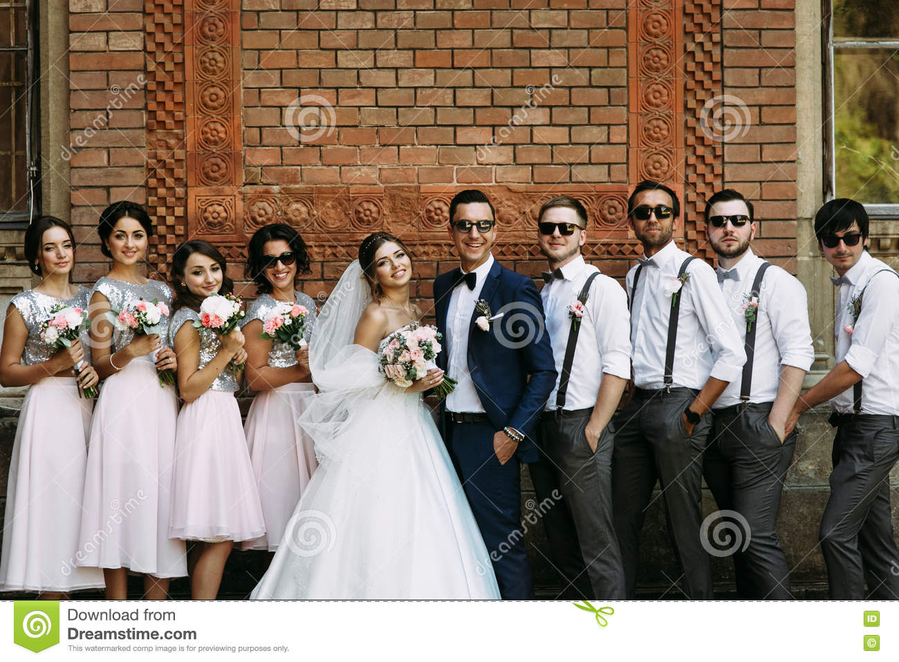 Cute couple with the friends in the wedding day
