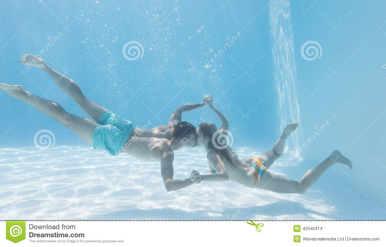 Cute couple holding hands underwater in the swimming pool for Cute pool pictures