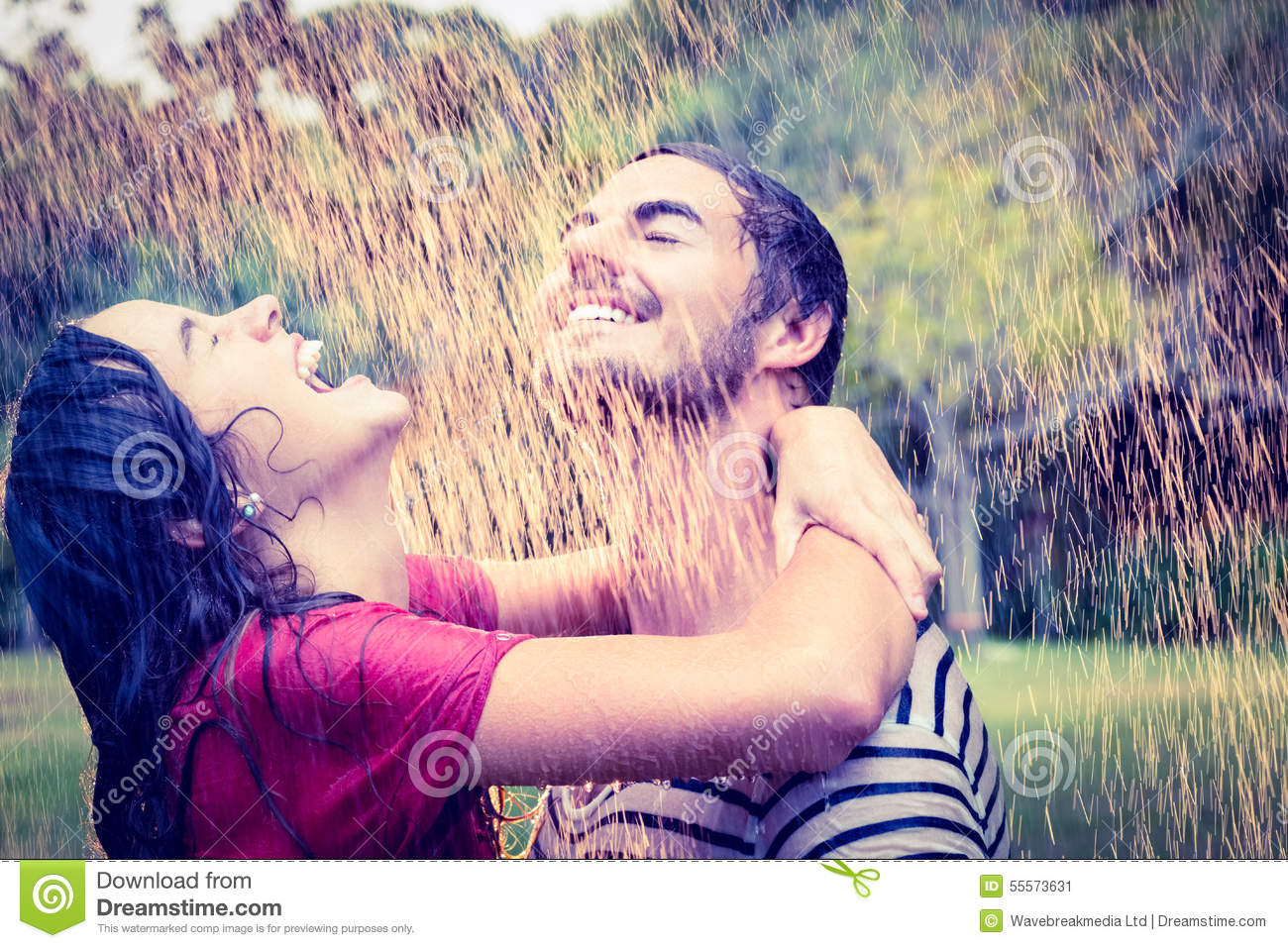 Couples Hugging In The Rain