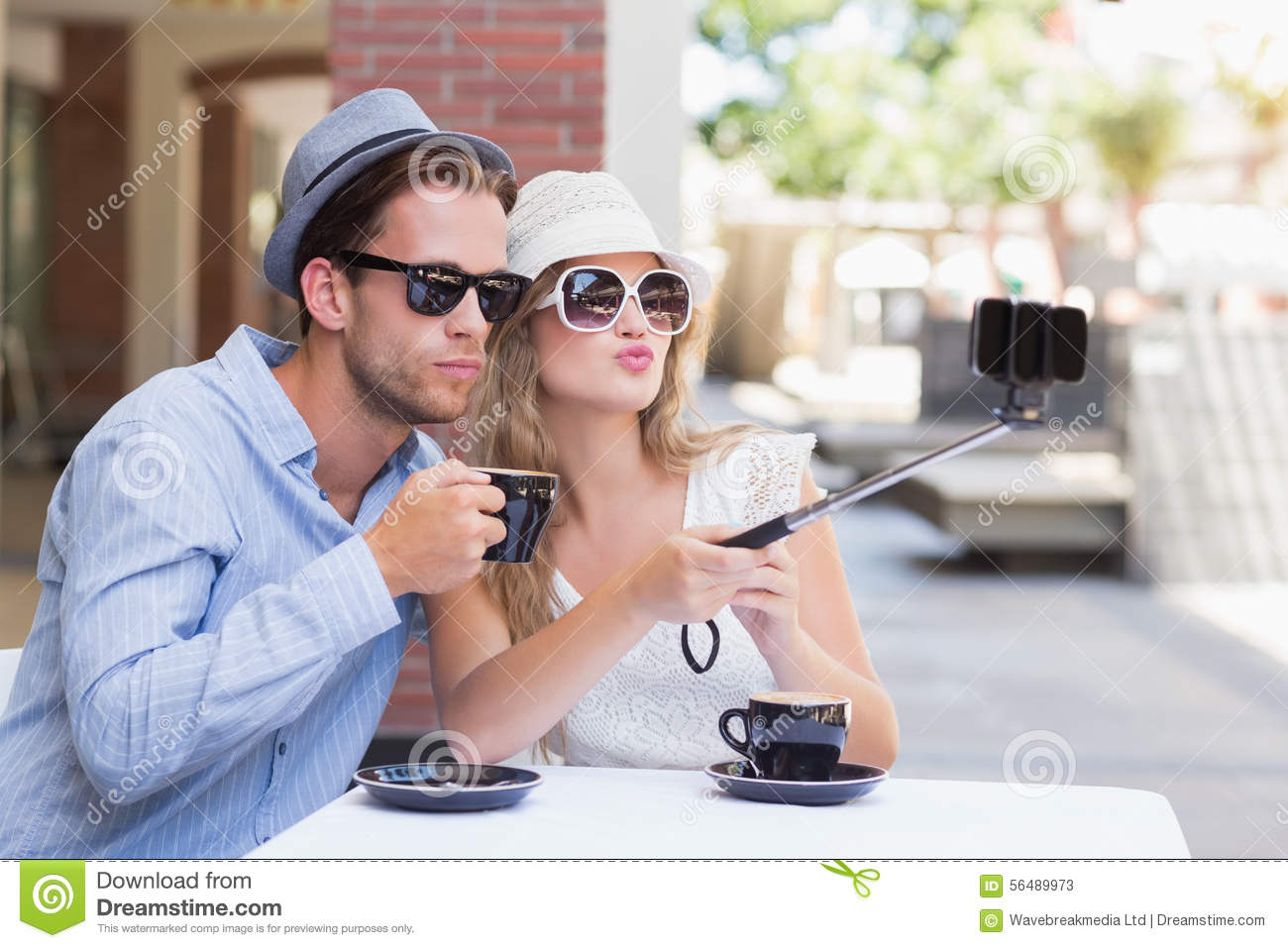 cute couple taking a selfie with selfie stick stock image image 56489973. Black Bedroom Furniture Sets. Home Design Ideas