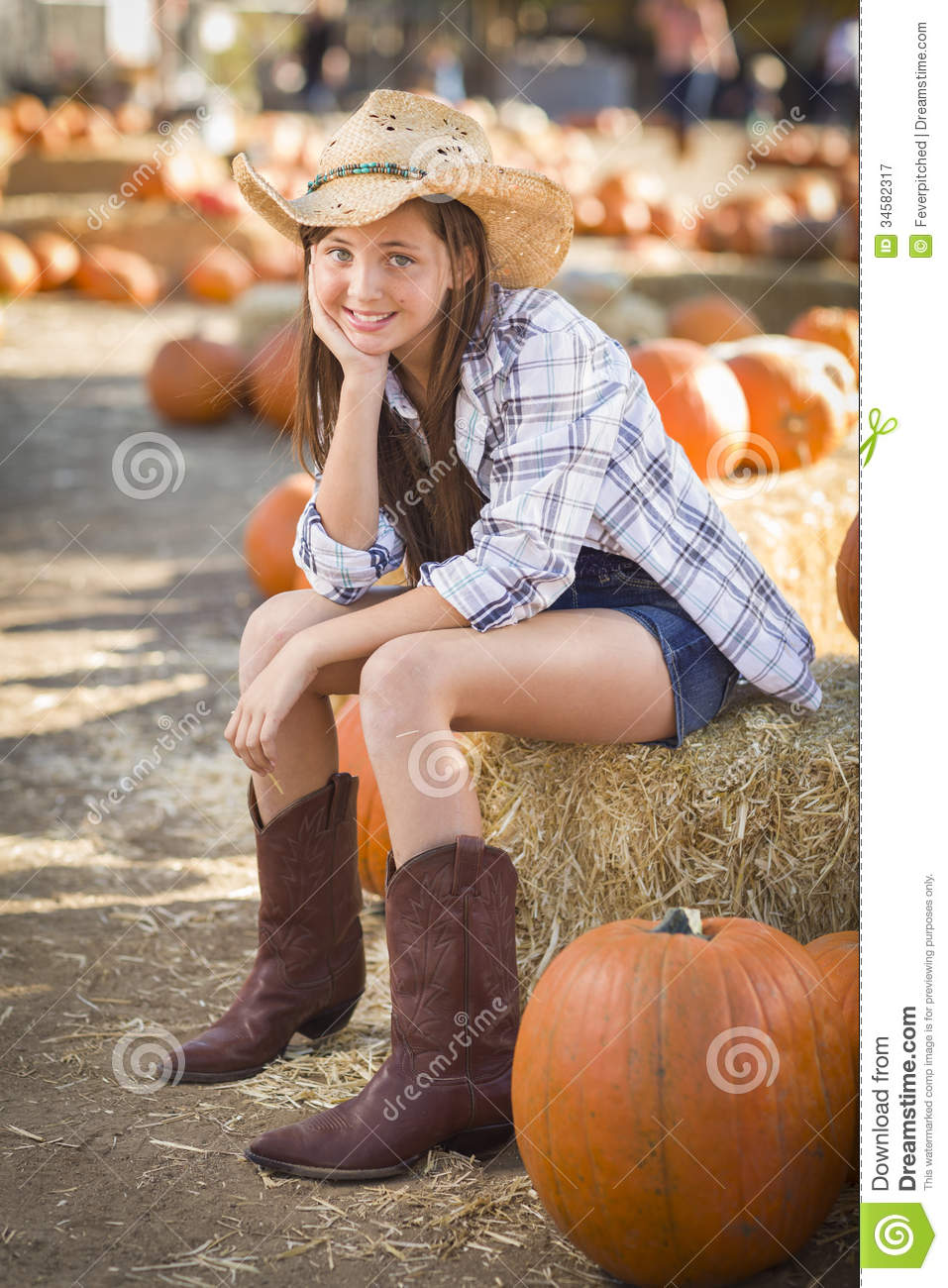 Cute Cowgirl In Hat And Boots At The Pumpkin Patch Royalty ...