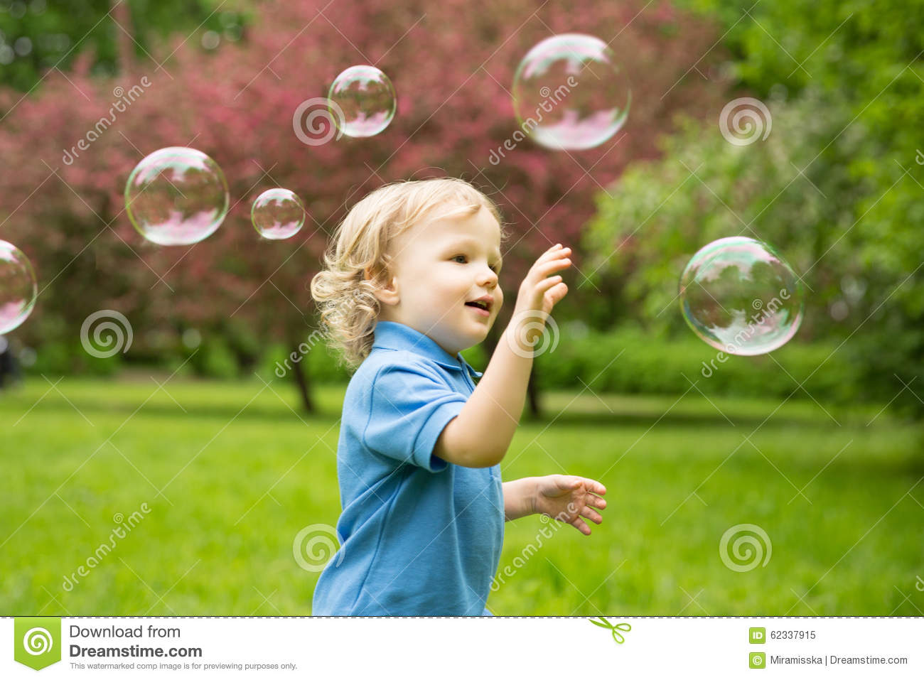 Cute Curly Baby With Soap Bubbles Children Playing Stock