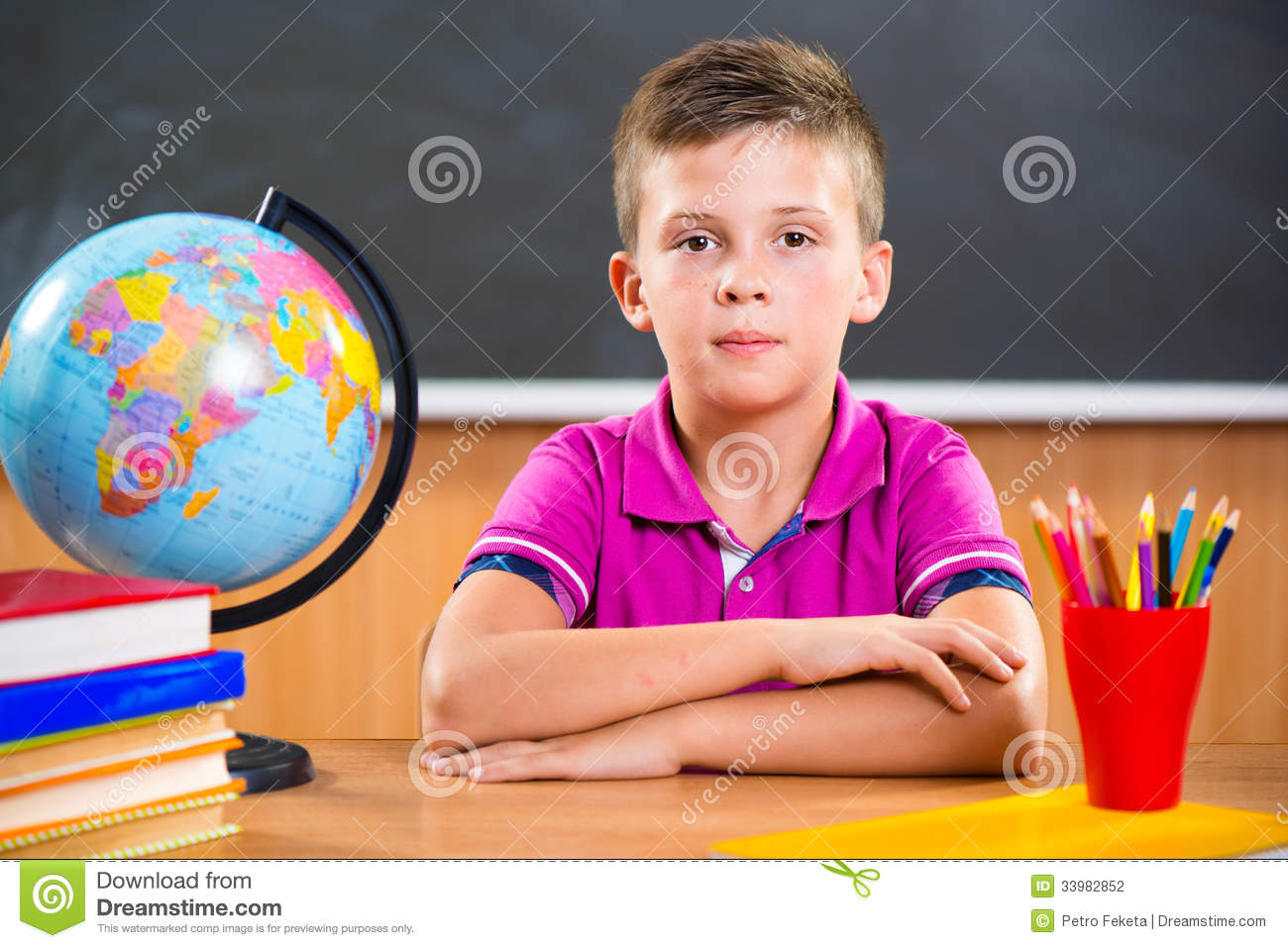 cute diligent boy sitting in classroom stock photography teacher helping student clipart teacher and student talking clipart