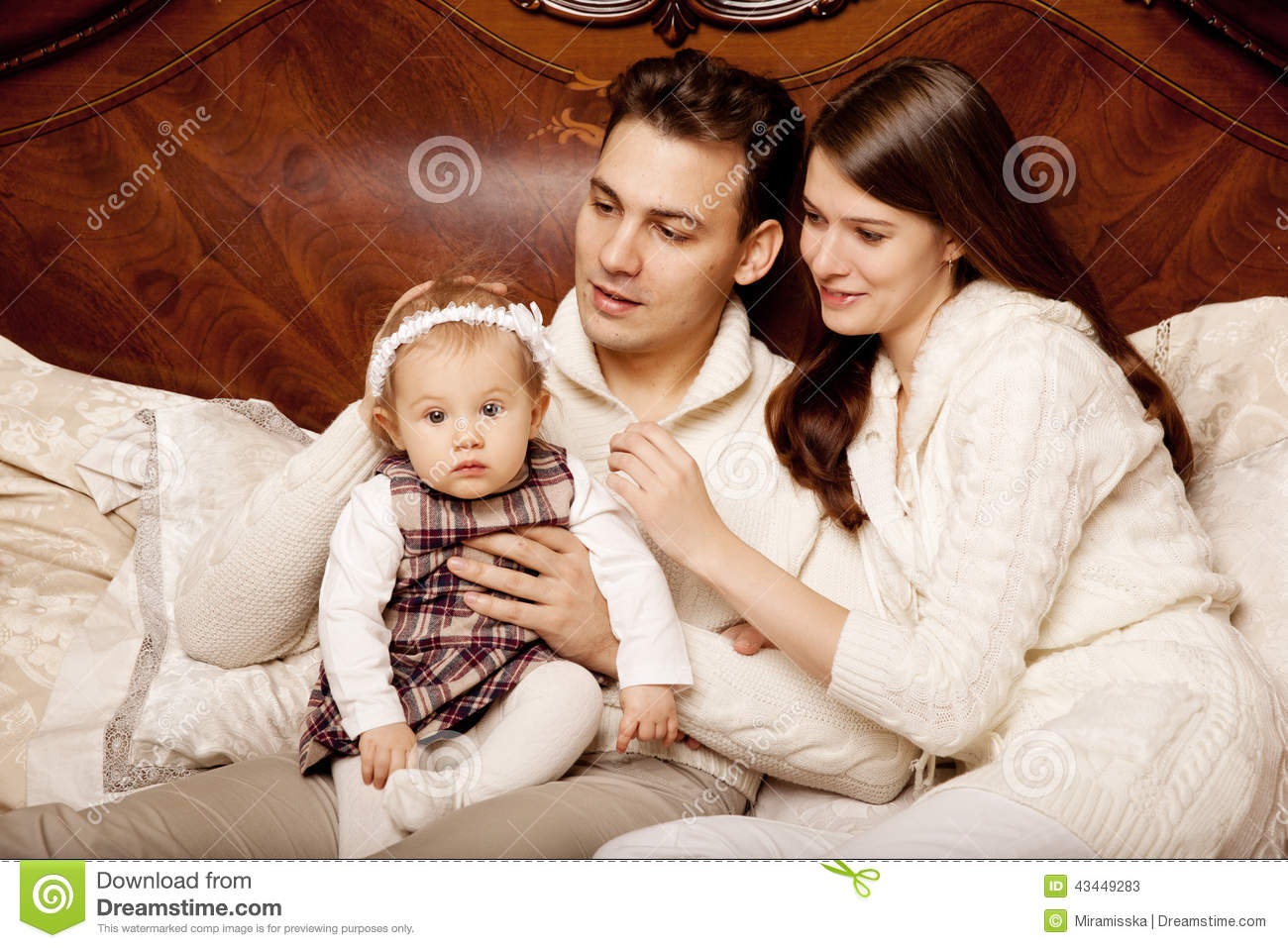 parenting family and little girl As a parent in the military you have many parenting resources available to you,  including military programs,  family sitting on couch with child hugging mother .