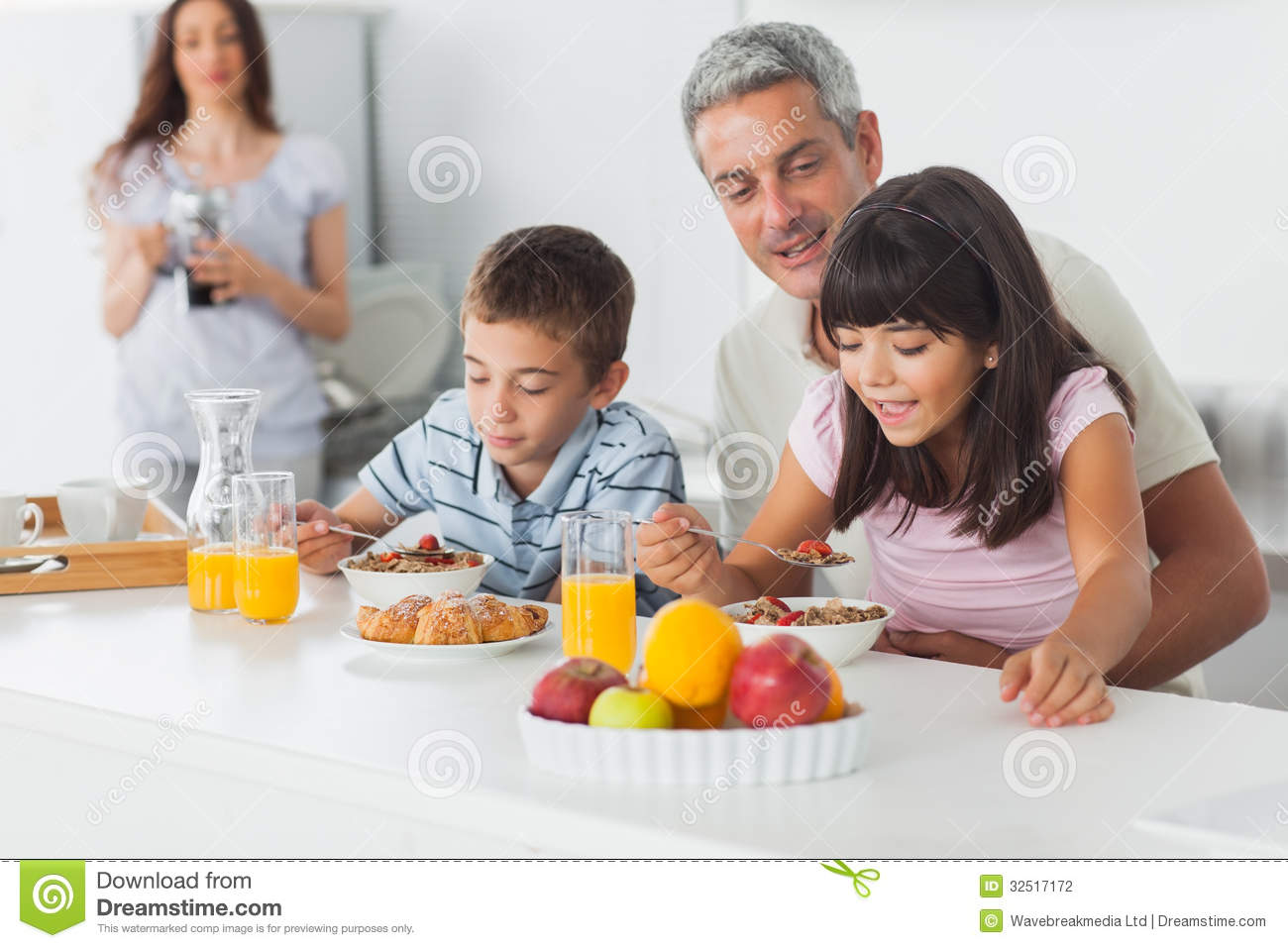 Cute Family Eating Breakfast In Kitchen Together Stock ...