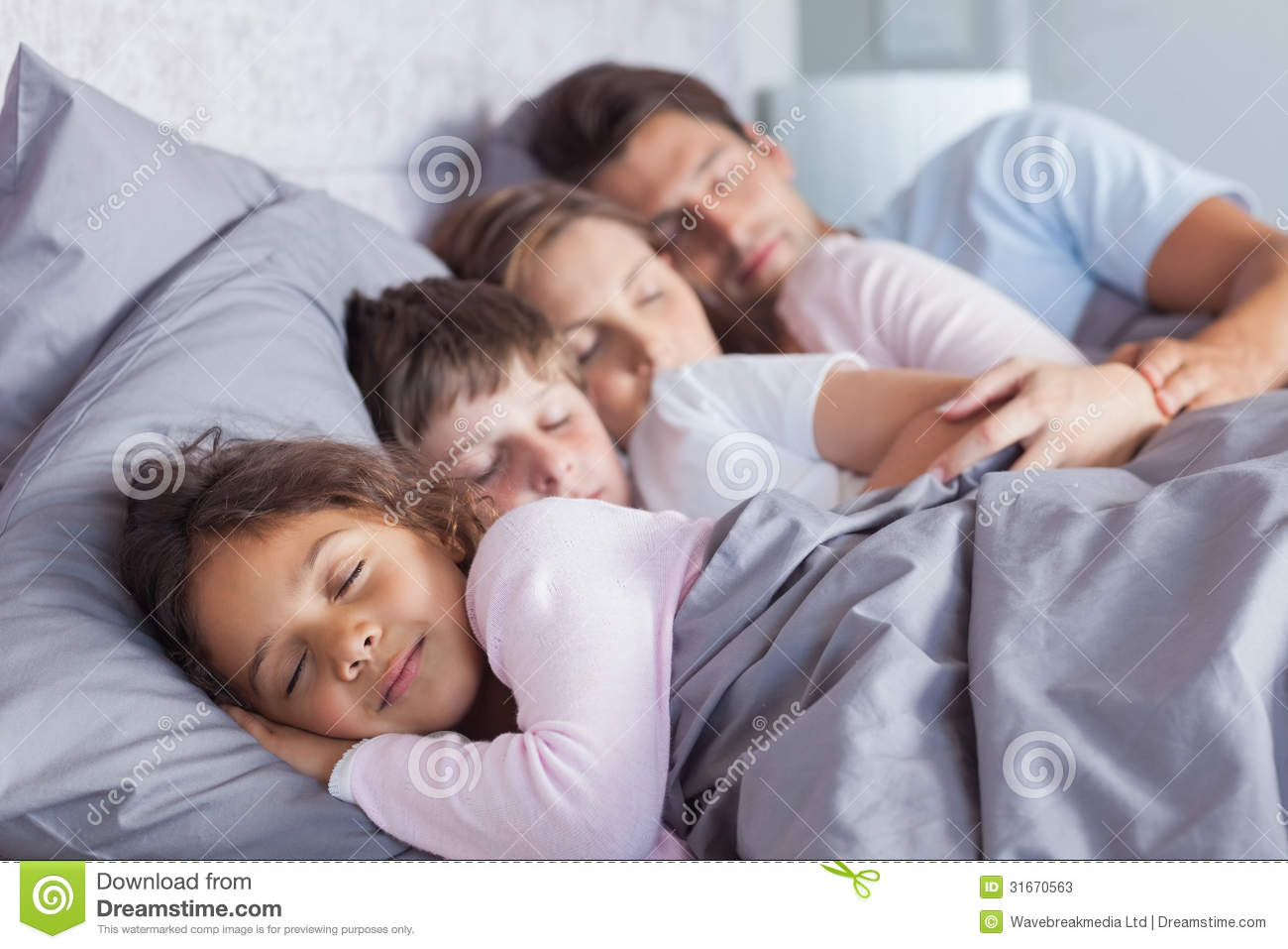 Cute family sleeping in bed. Cute Family Sleeping In Bed Stock Image   Image  31670563