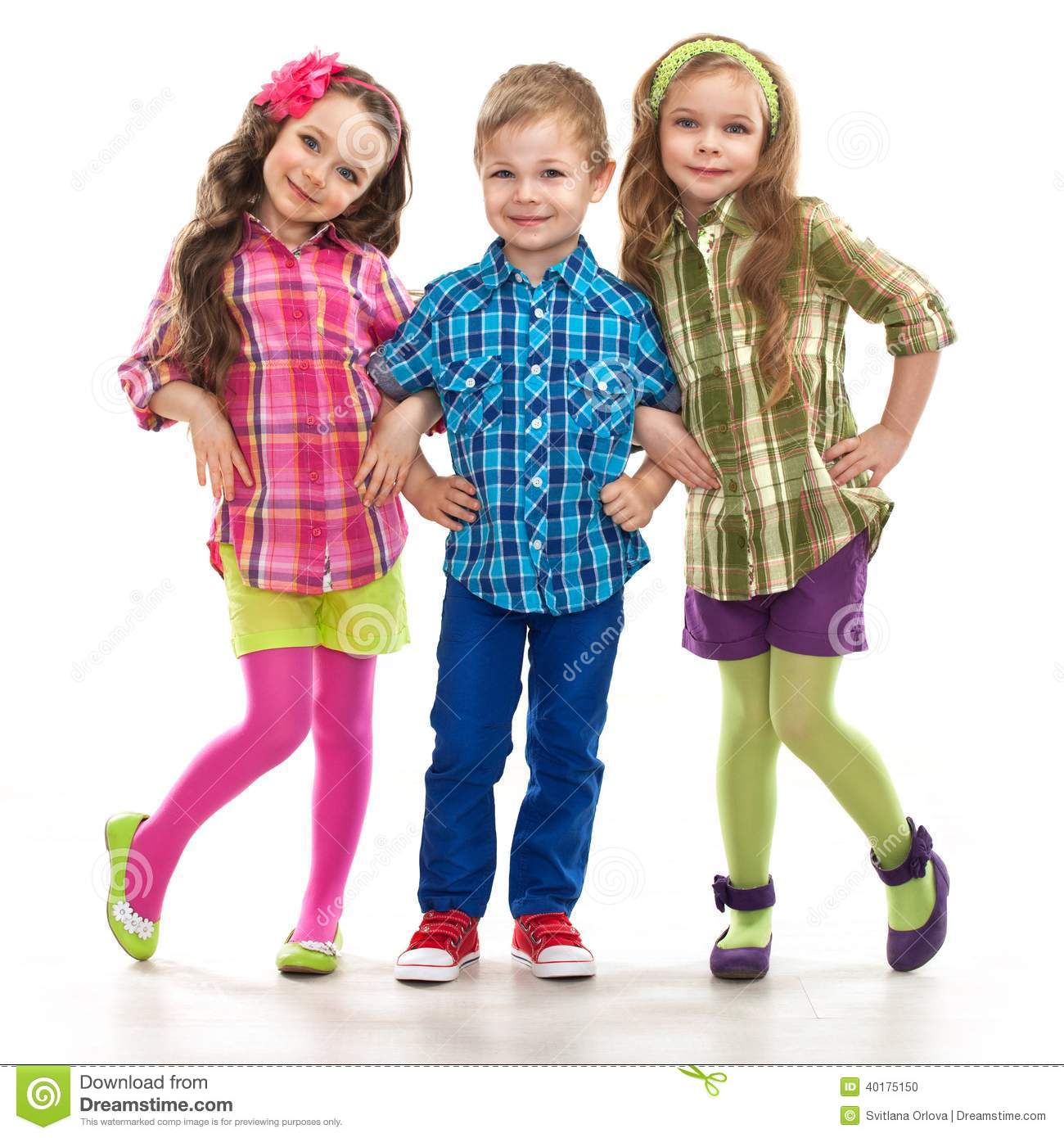2cedd3bdcc3 Cute fashion kids are standing together, on the white background .  Fashionable and friendship concept
