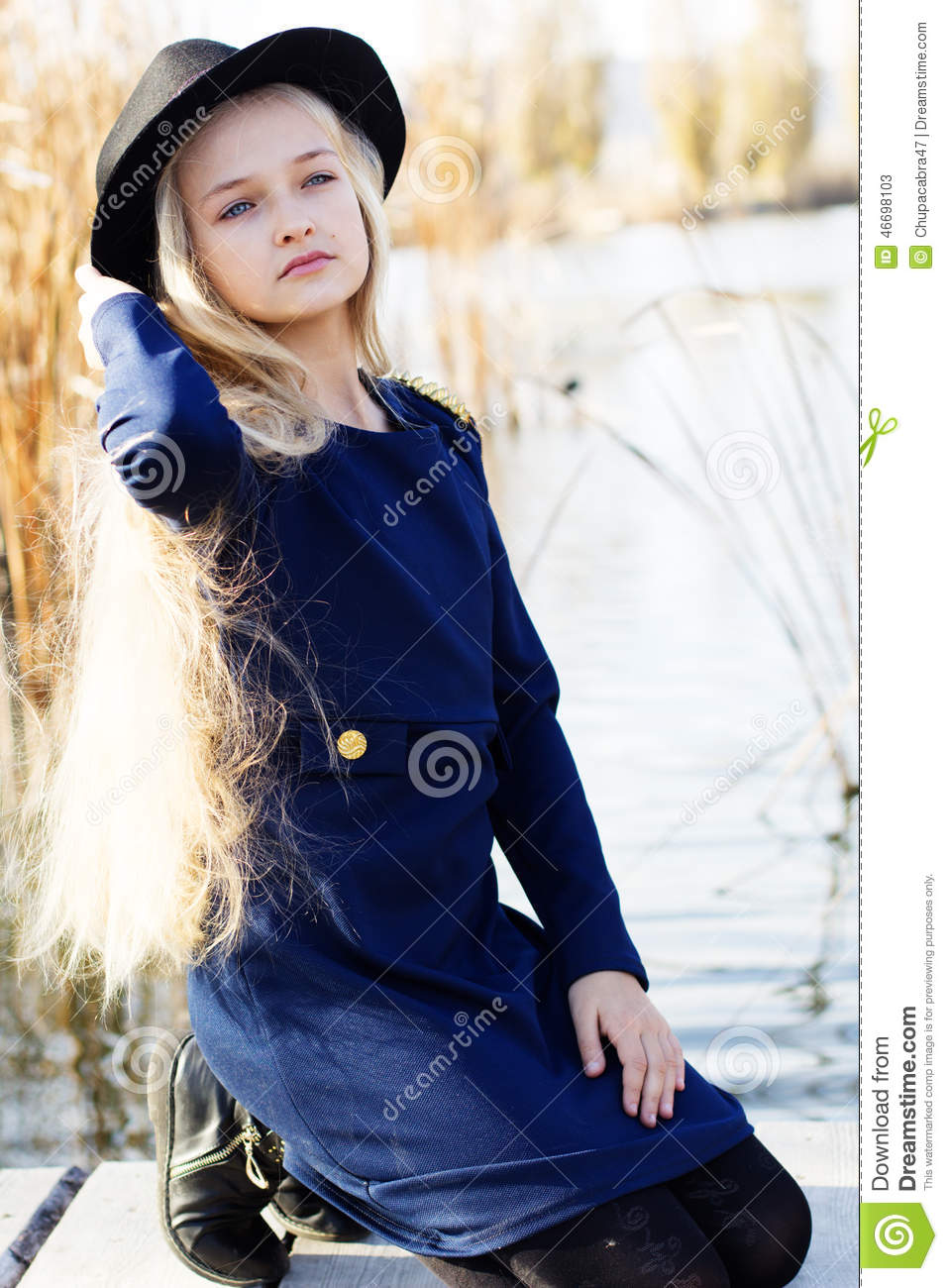 Cute Fashion Little Girl Is Resting Near Lake Stock Image - Image ...