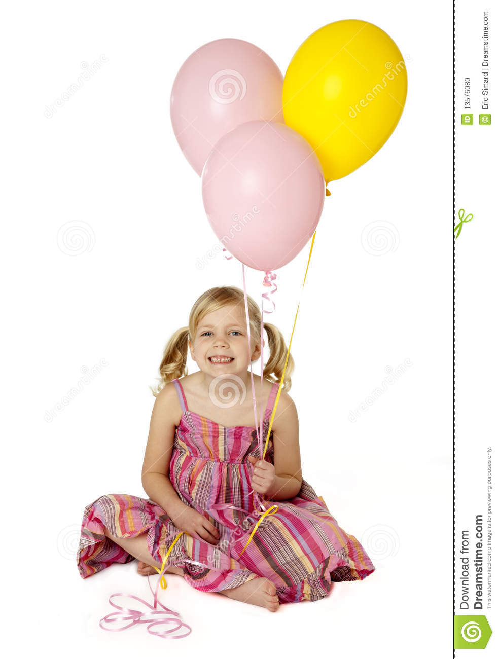 Cute Female Child Holding Balloons