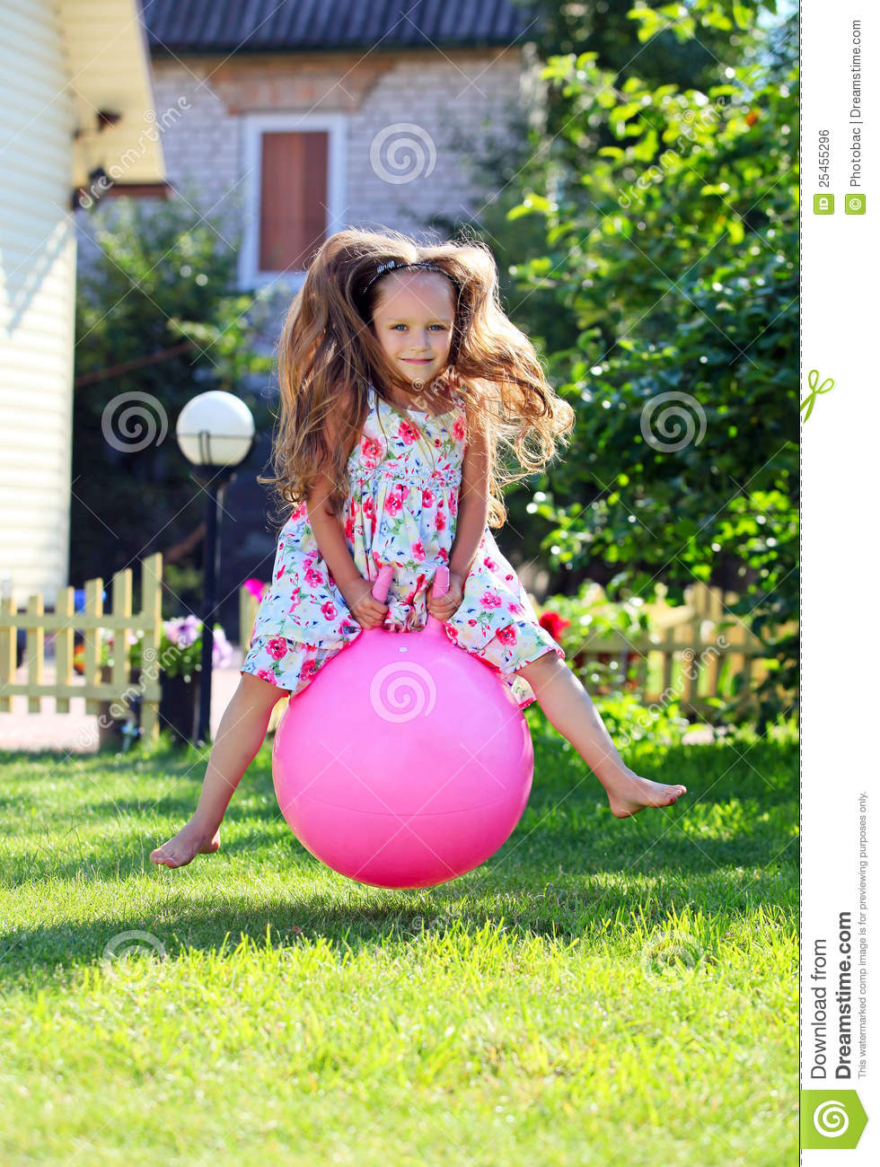 Adorable Four Year Boy With Big Blue Eyes Stock Image: Cute Four-year Girl Bouncing On A Big Ball Stock Photo