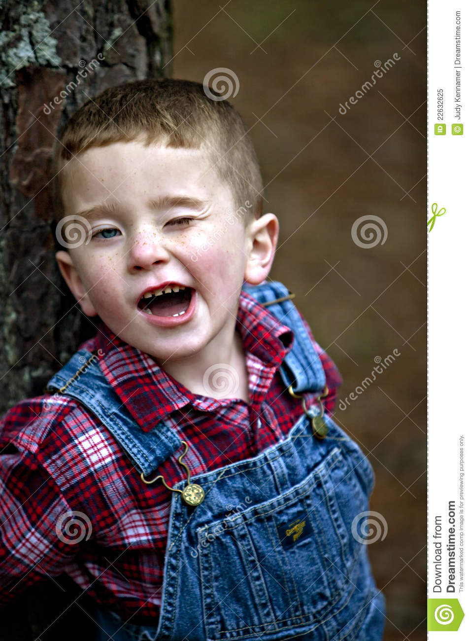 Cute Freckled Redheaded Boy Winking Royalty Free Stock