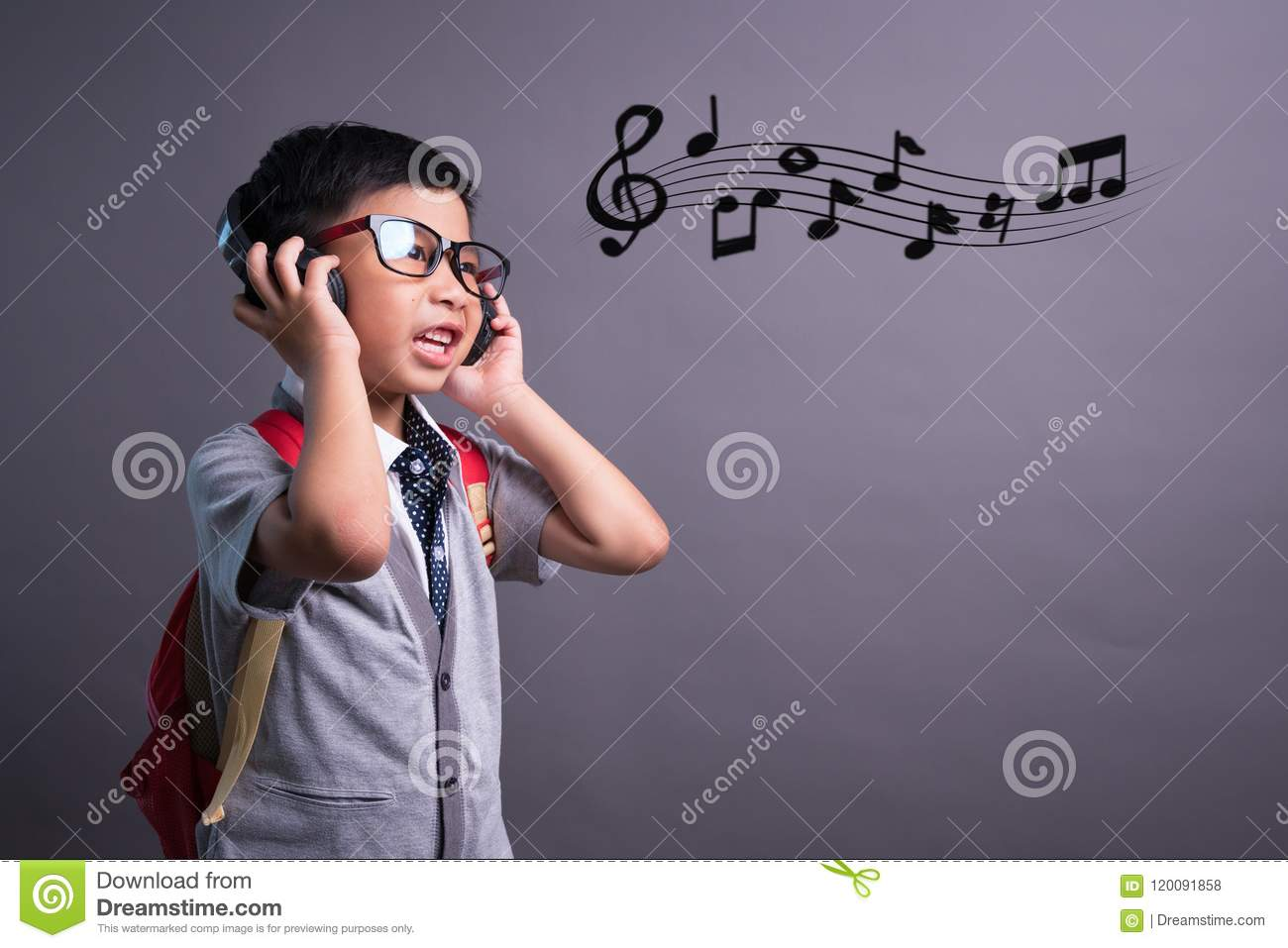 Cute funny children in dance studio, Cute little boy in headphones listening to music on color background