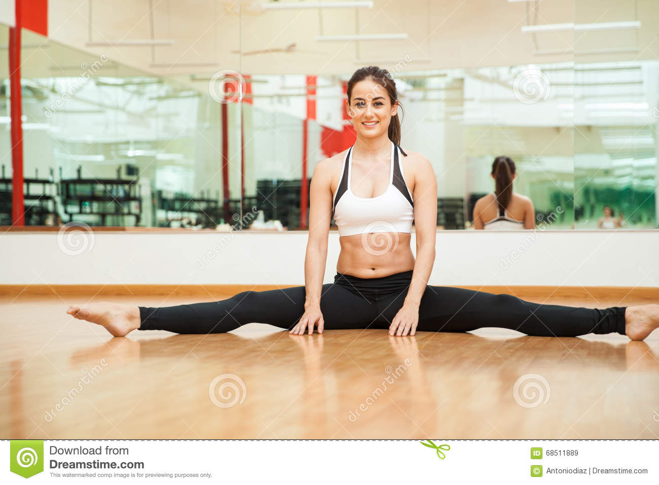 Cute Girl With Abs Doing A Leg Split Stock Photo Image