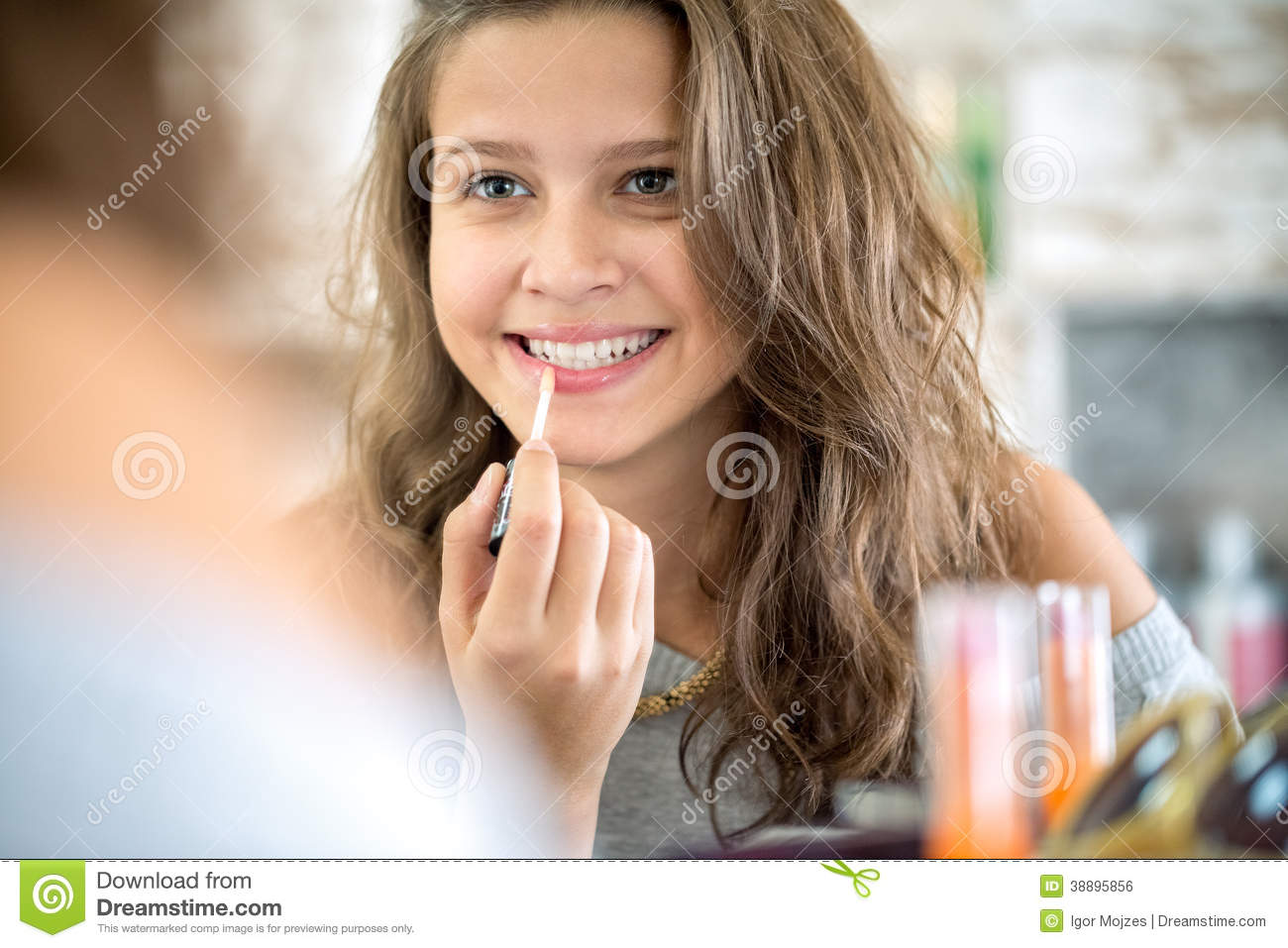 Cute girl applying lip gloss stock photo image 38895856 for Cute teenager girls