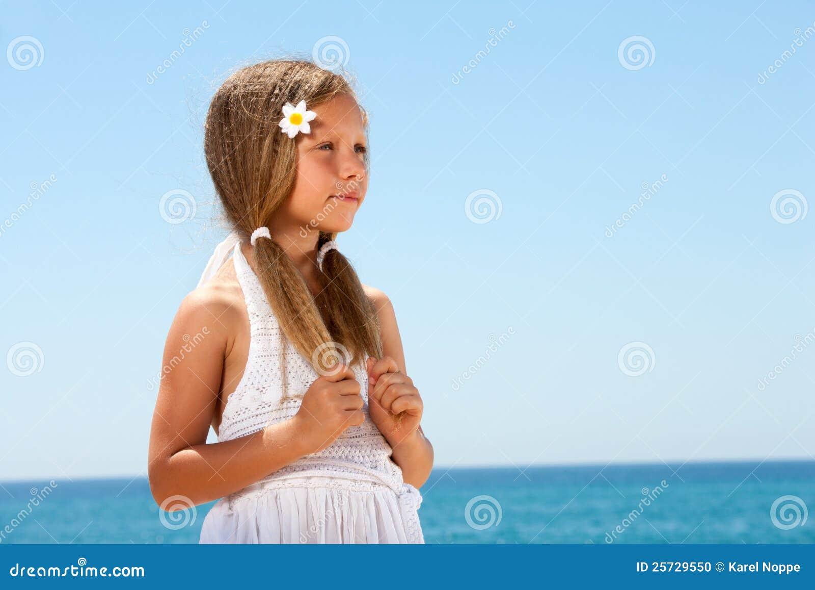 Cute girl on beach staring.