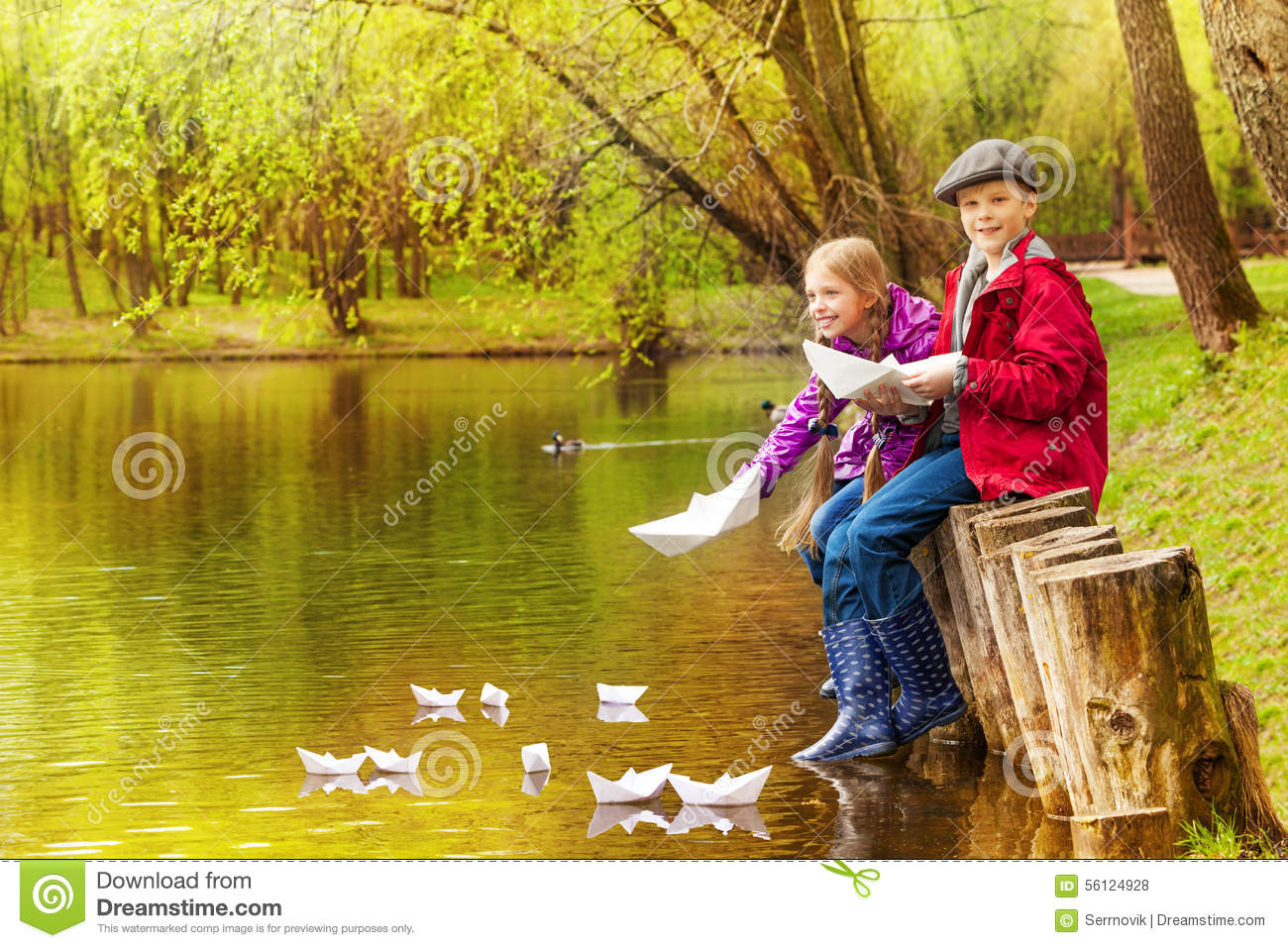 Cute Girl And Boy Play With Paper Boats On Pond Stock Photo Image