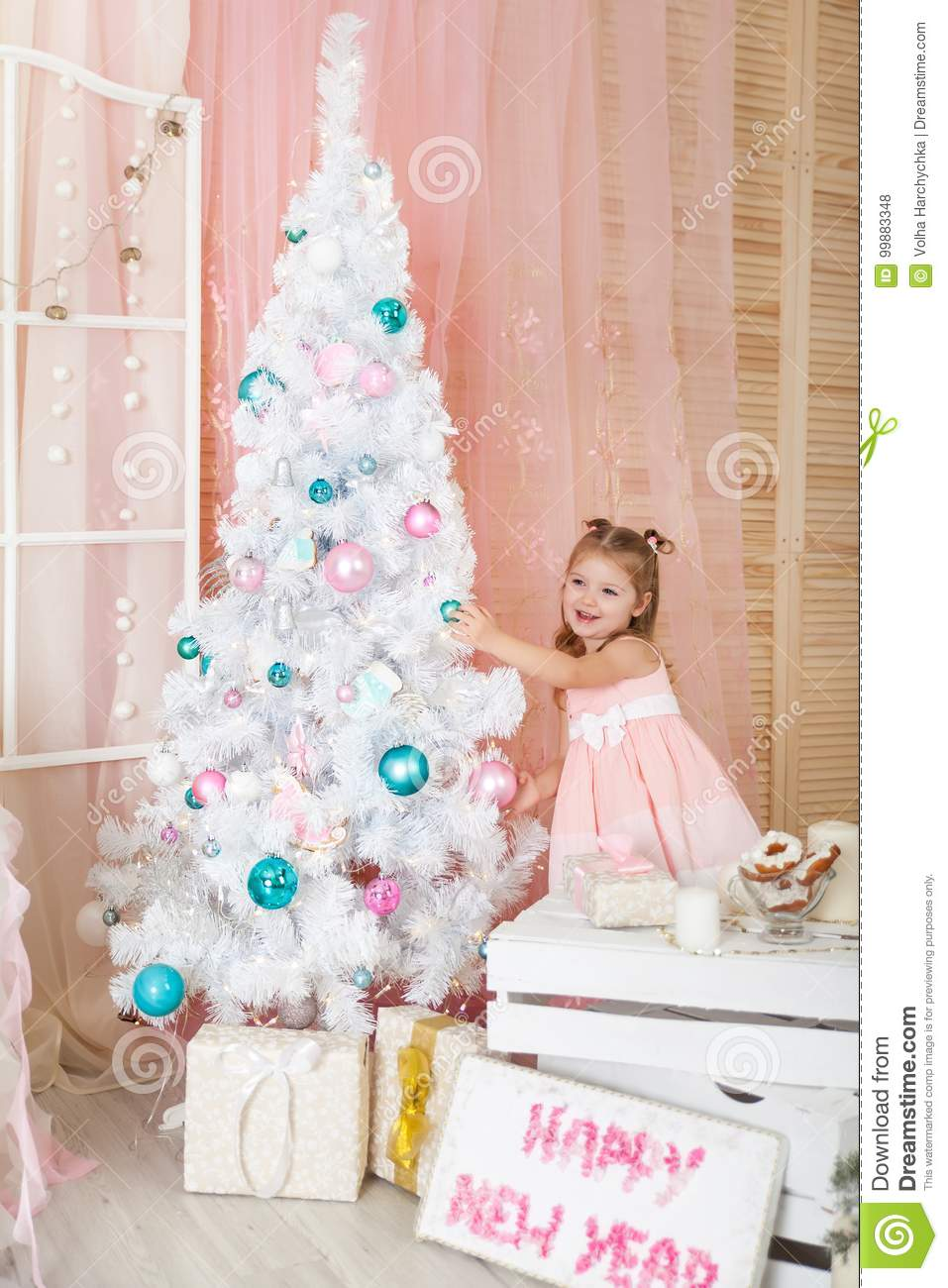 cute girl in a christmas decorated studio in pastel colors - Pastel Christmas Decorations