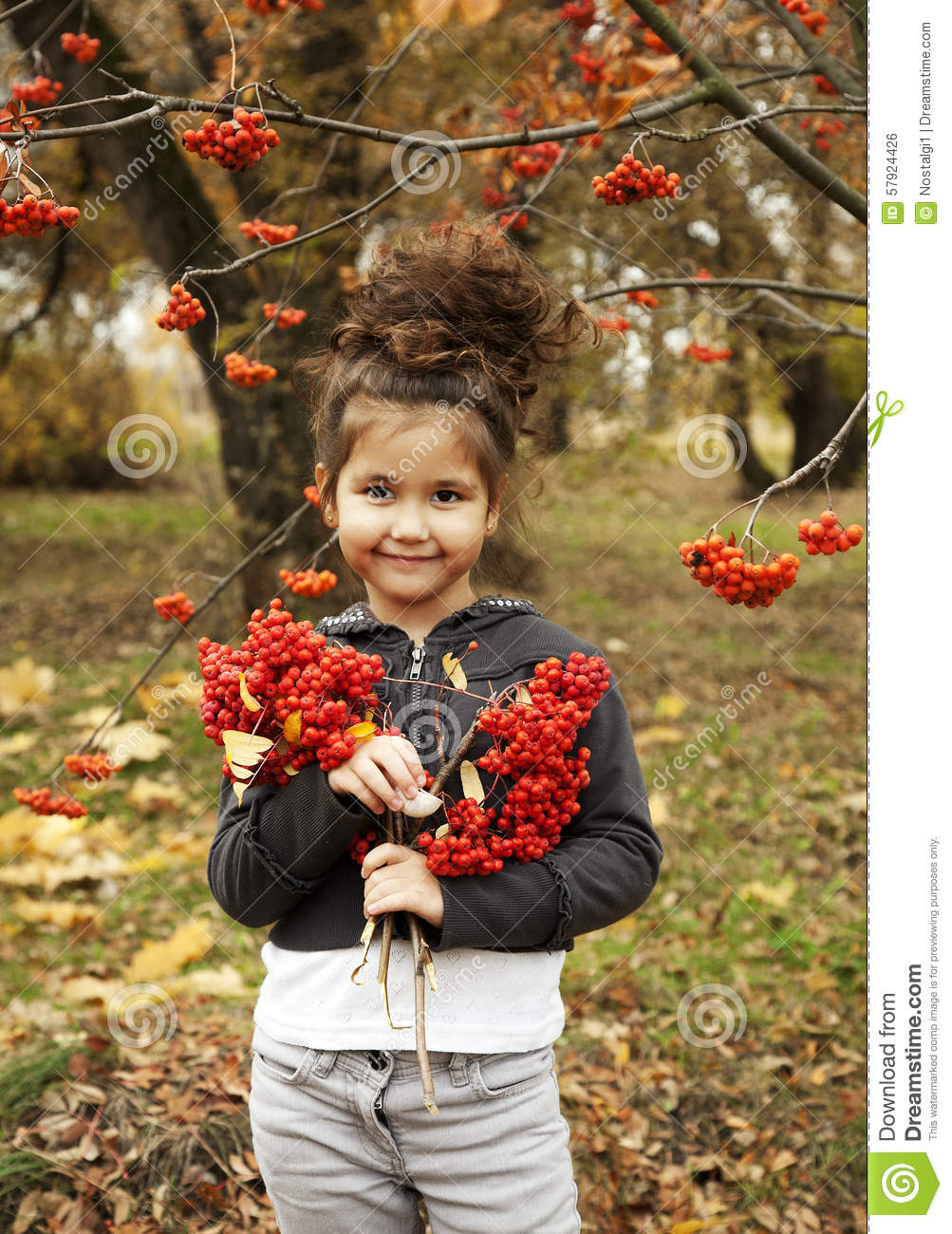 Outstanding Cute Girl With Dark Curly Hair In The Autumn Forest Stock Photo Short Hairstyles For Black Women Fulllsitofus