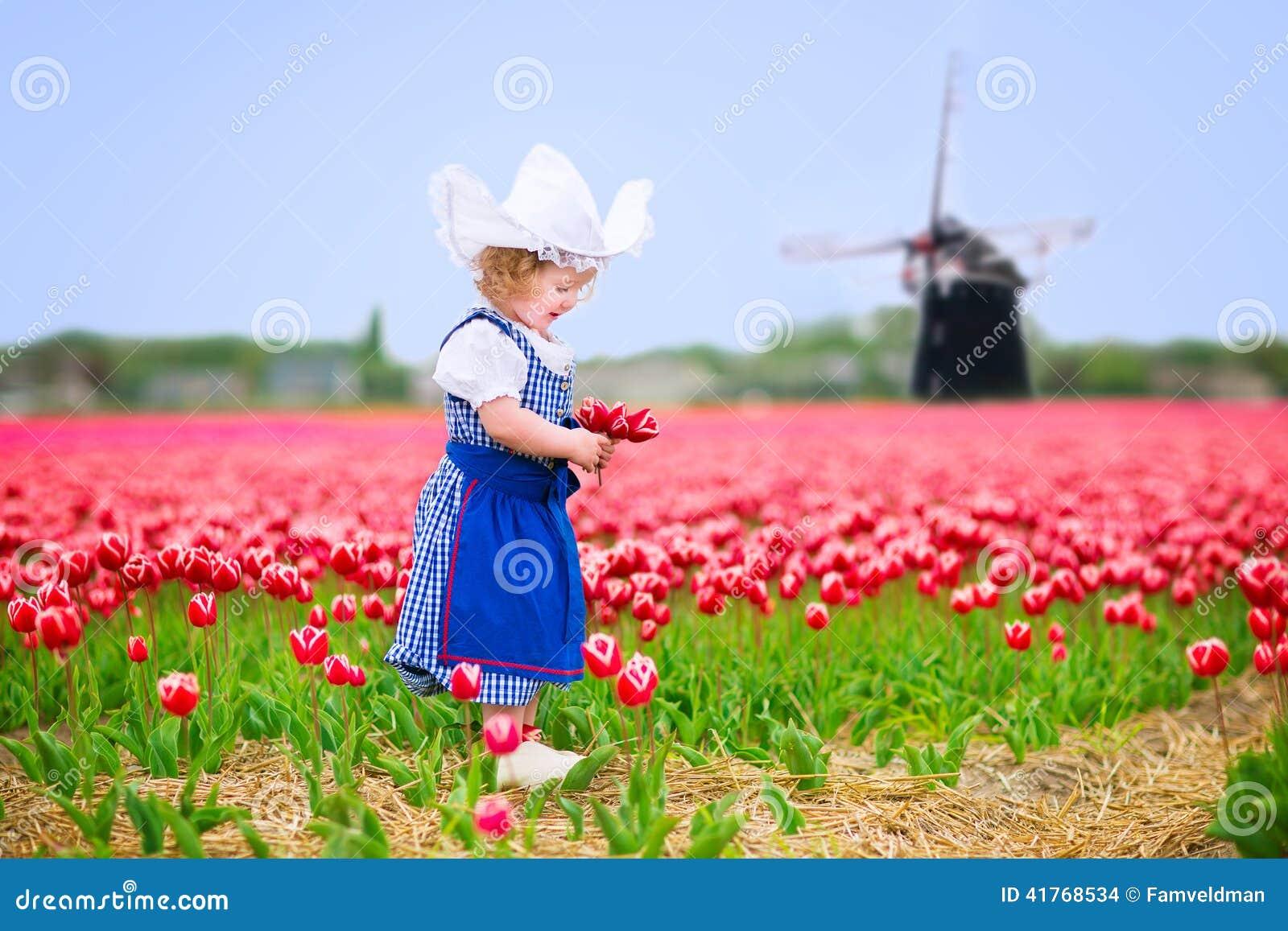 Cute Girl In Dutch Costume In Tulips Field With Windmill ... Cutedutch Nl