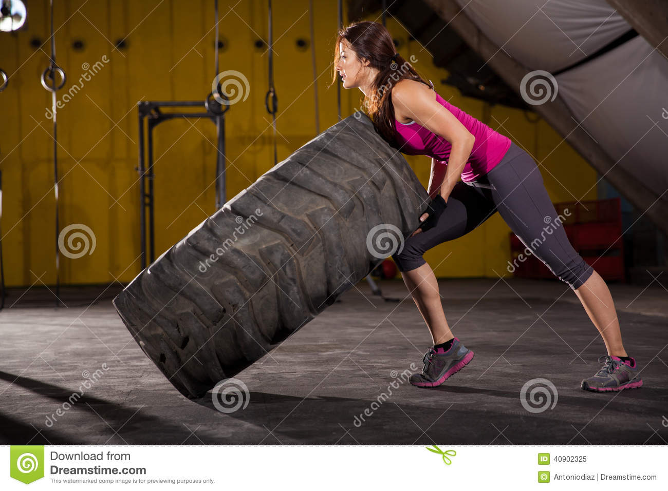Cute girl flipping a tire stock image. Image of profile - 40902325