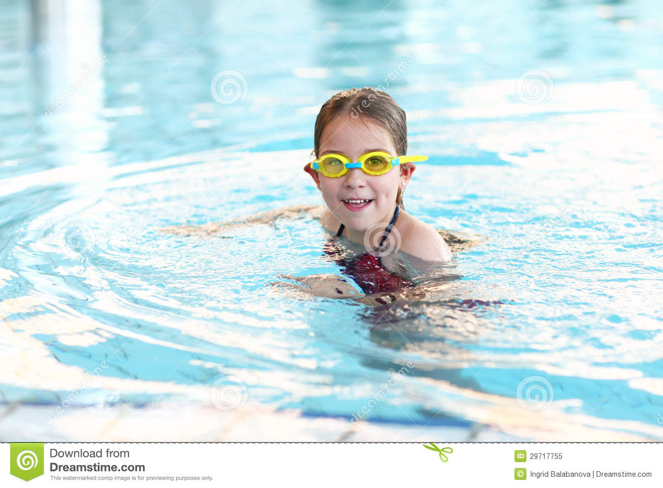 Schoolgirl with goggles in swimming pool royalty free for Cute pool pictures