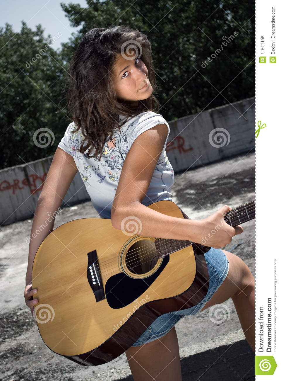Cute girl holding guitar