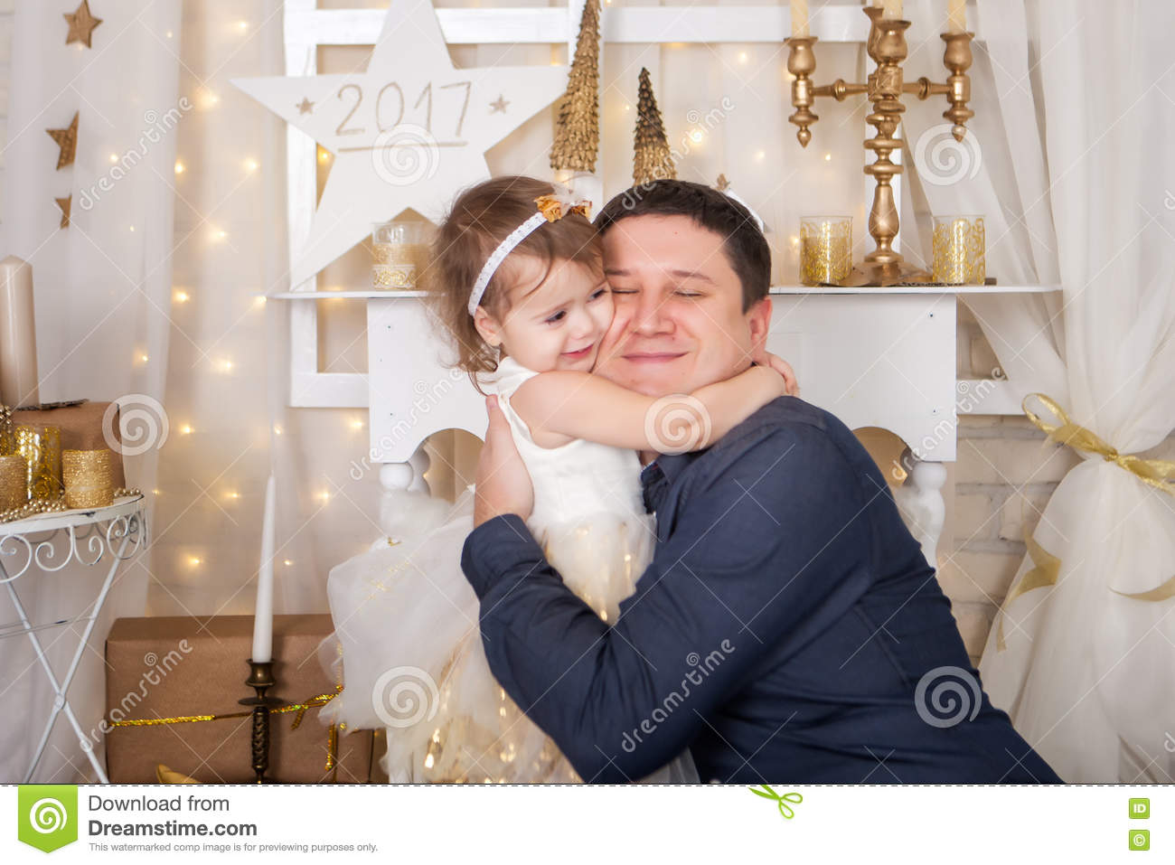 Cute girl hugs her father