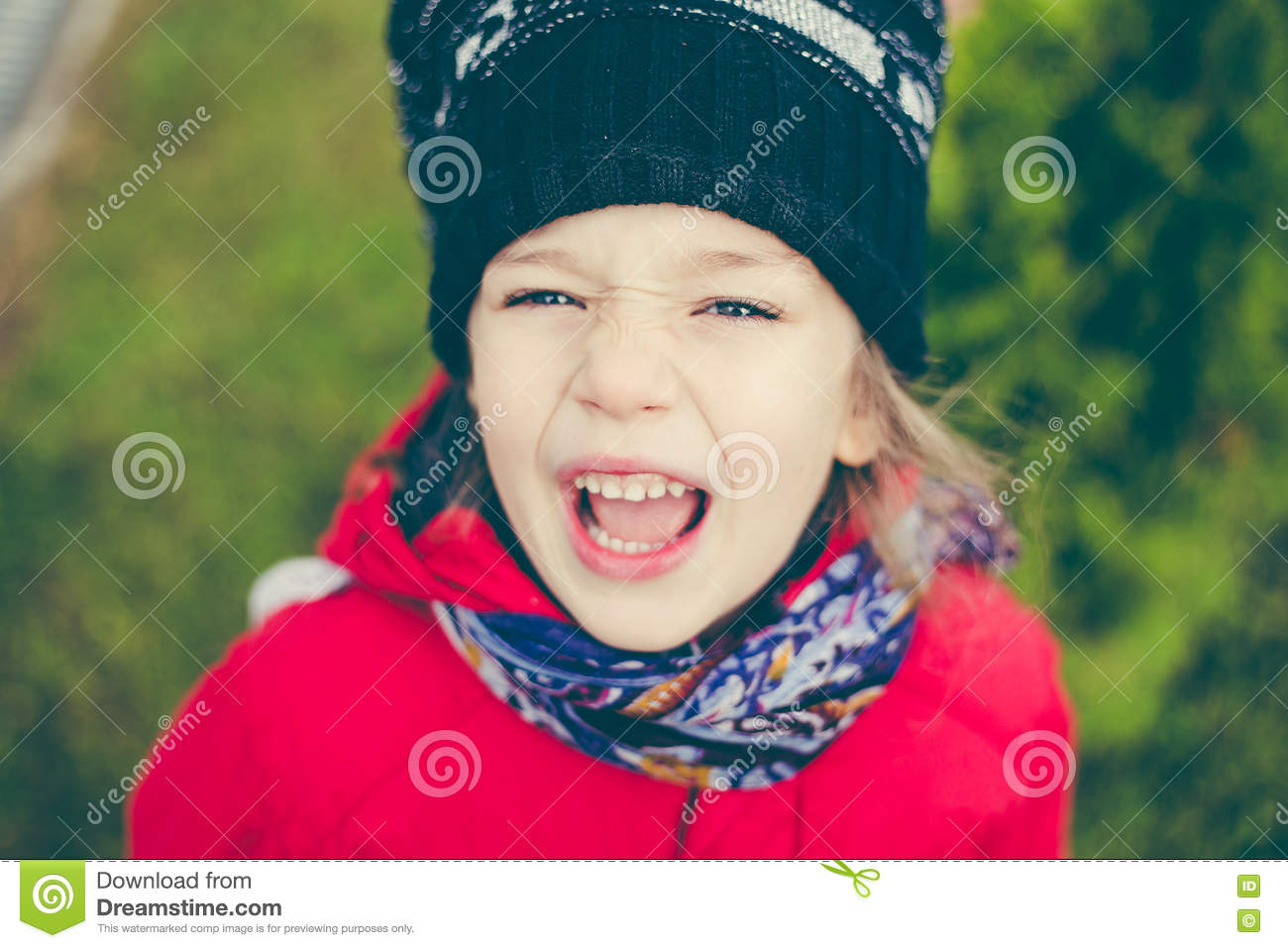 6788cc0d1 Cute Girl In A Jacket And Hat On The Stree Stock Image - Image of ...