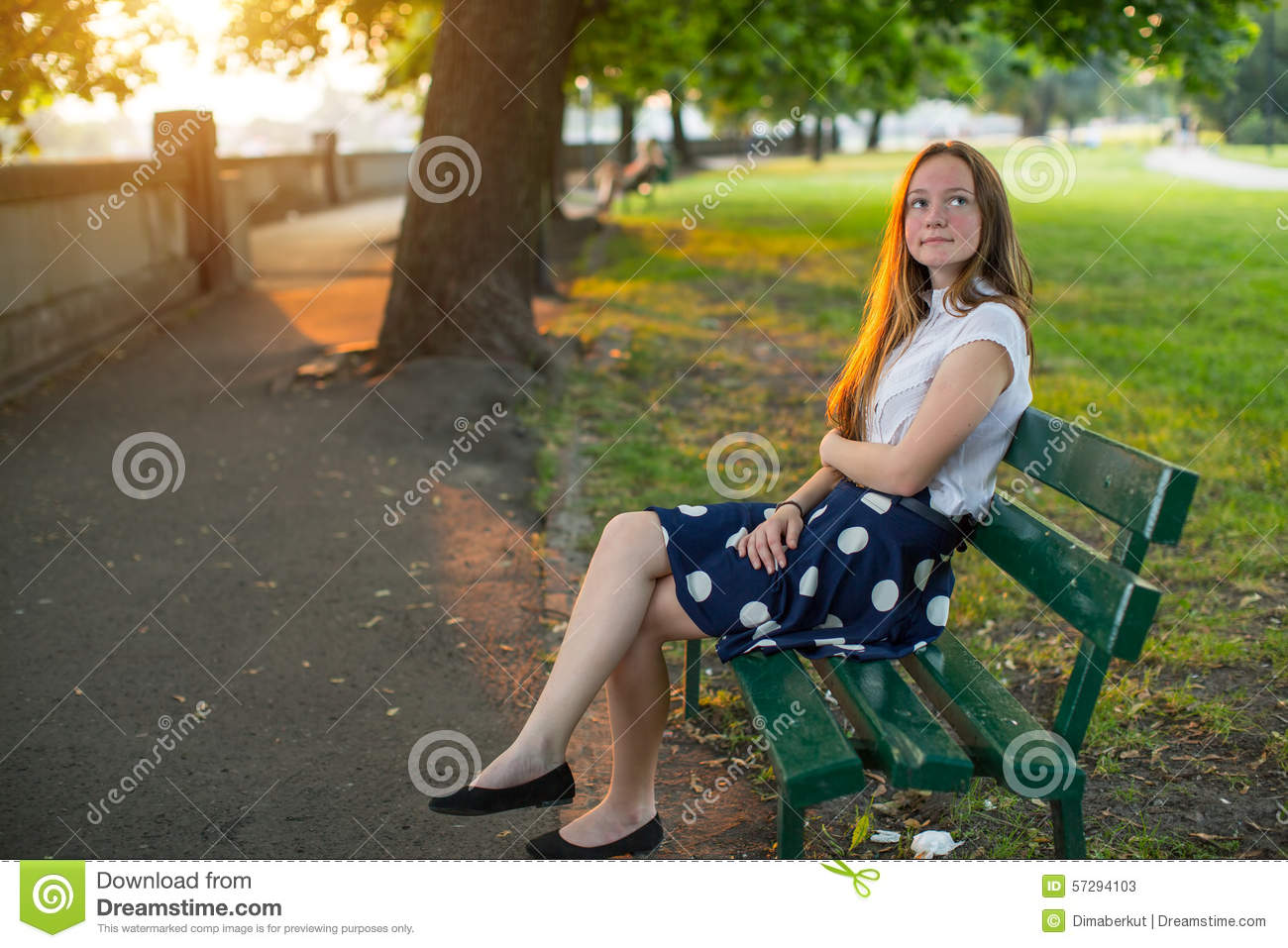 Girl Sitting Alone On Bench Cute Girl With Long Go...