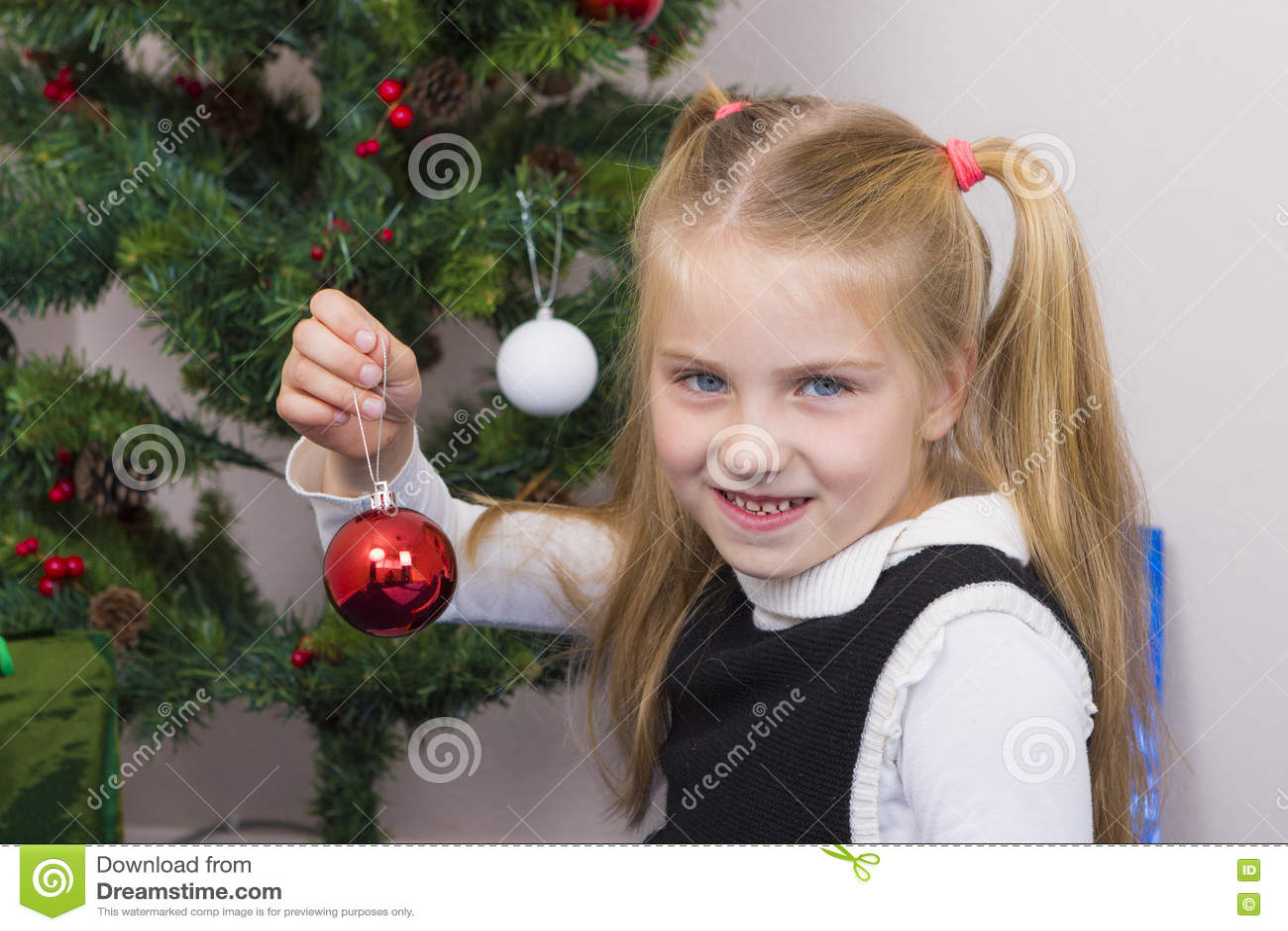 Cute girl near New Year tree