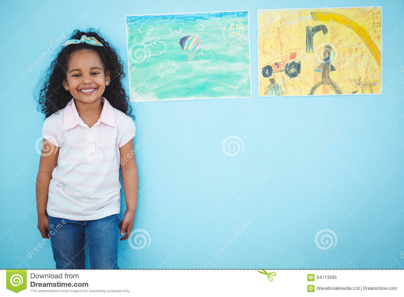 Cute girl next to drawings